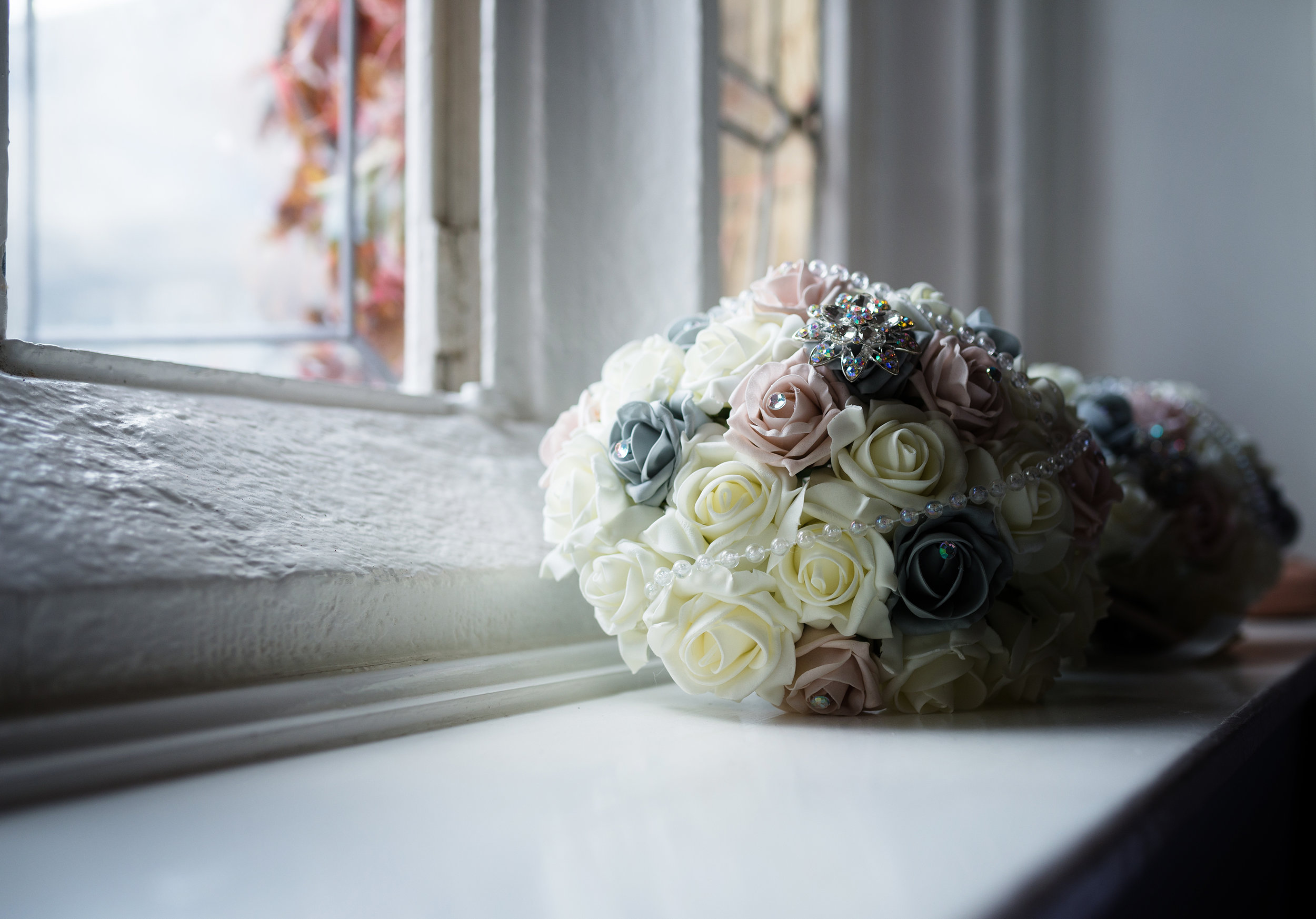 Bridal bouquet on a window ledge