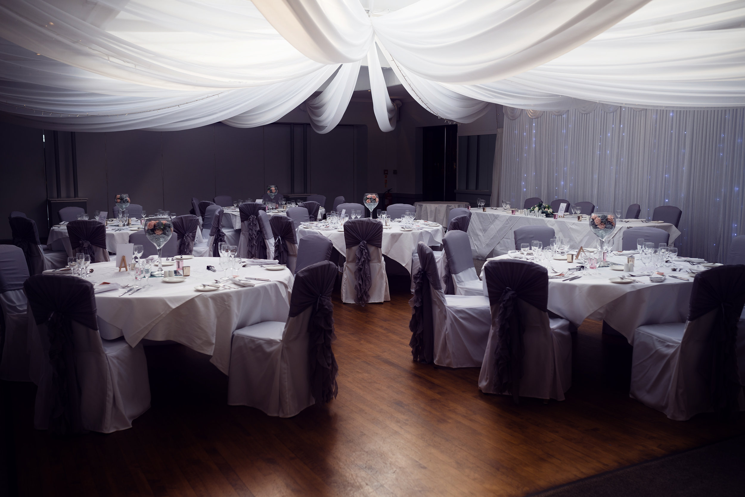 Wedding breakfast room setup at Stirk House