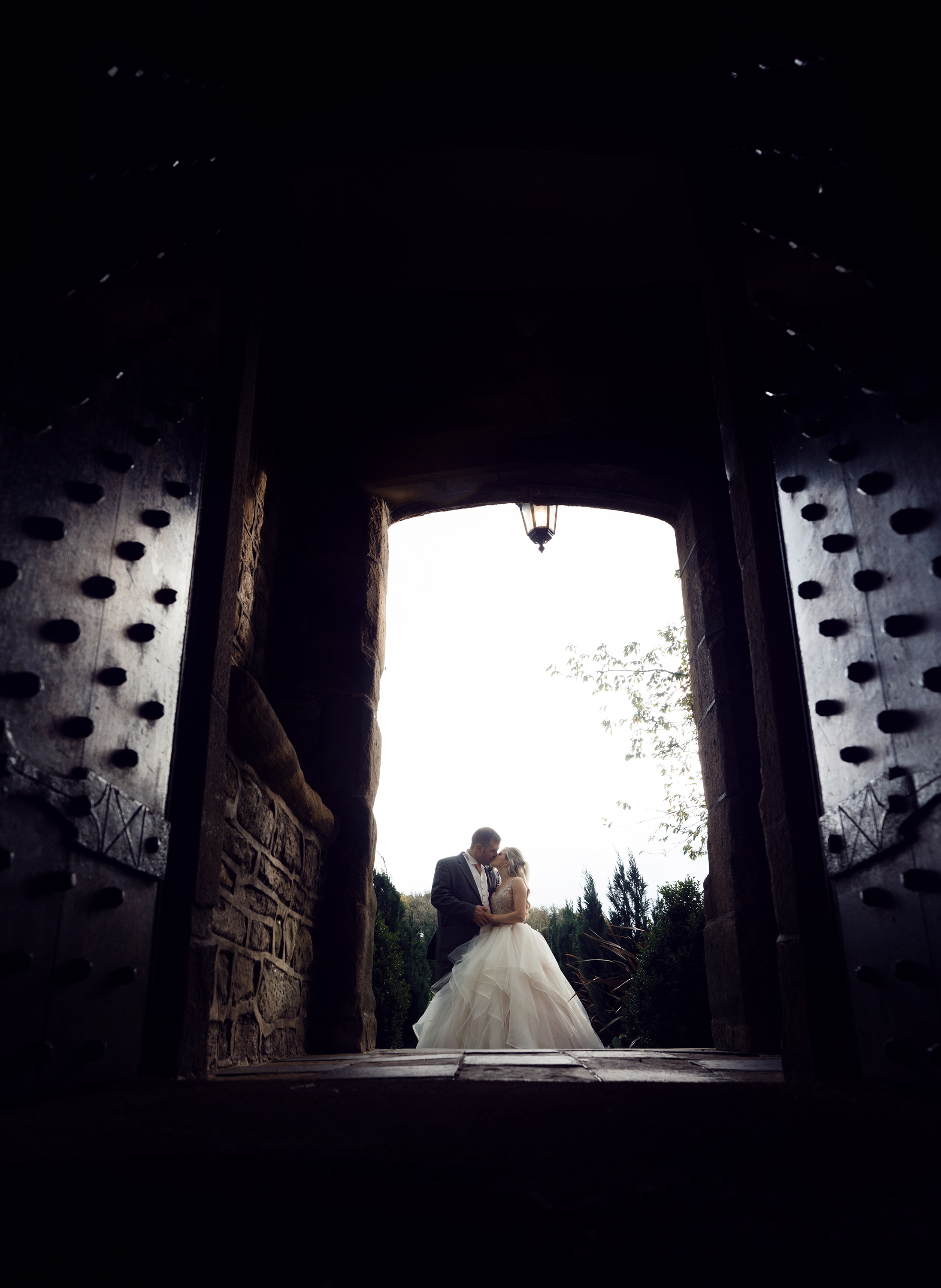 The bride and groom through the doorway