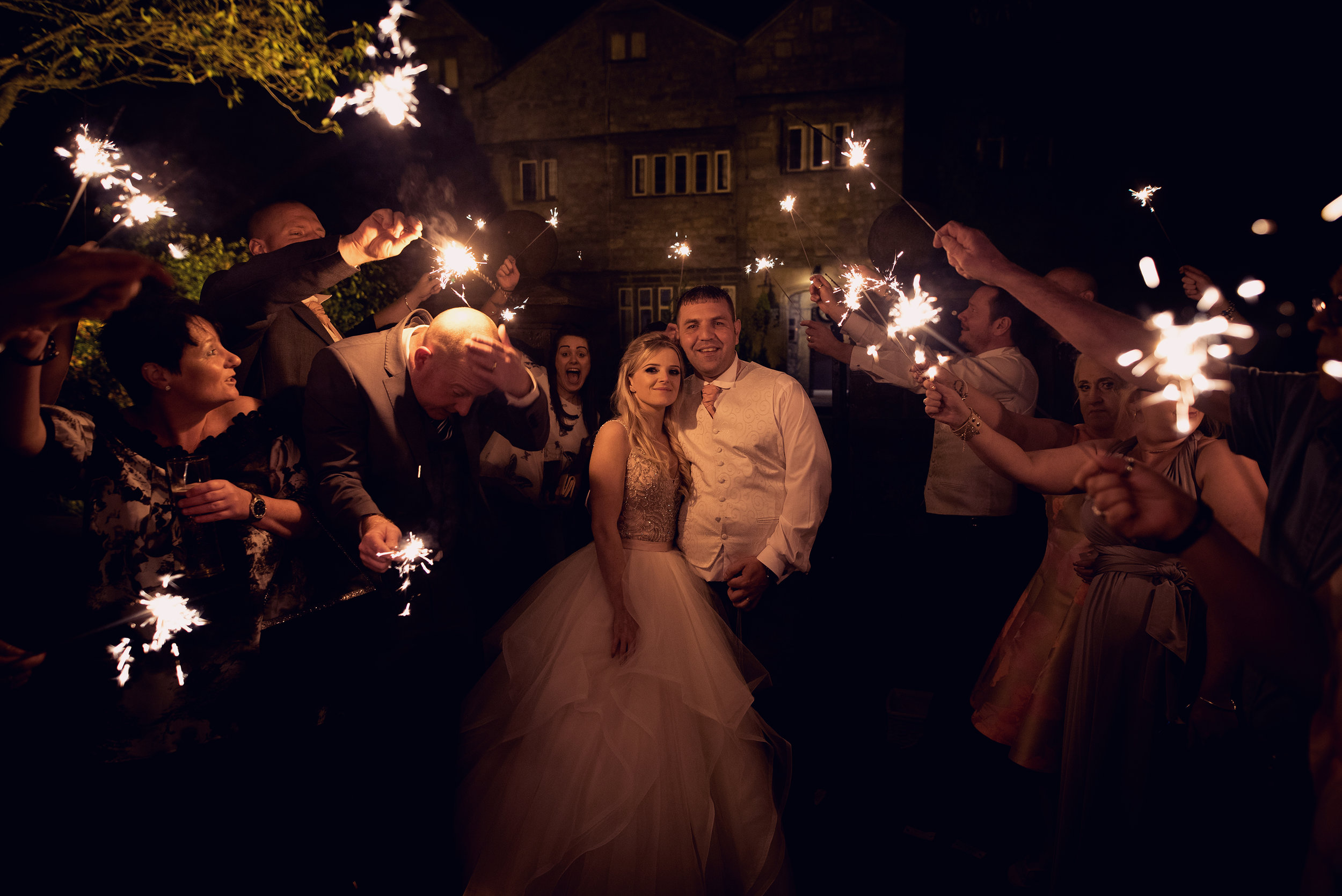 Bride and Groom with guests and sparklers