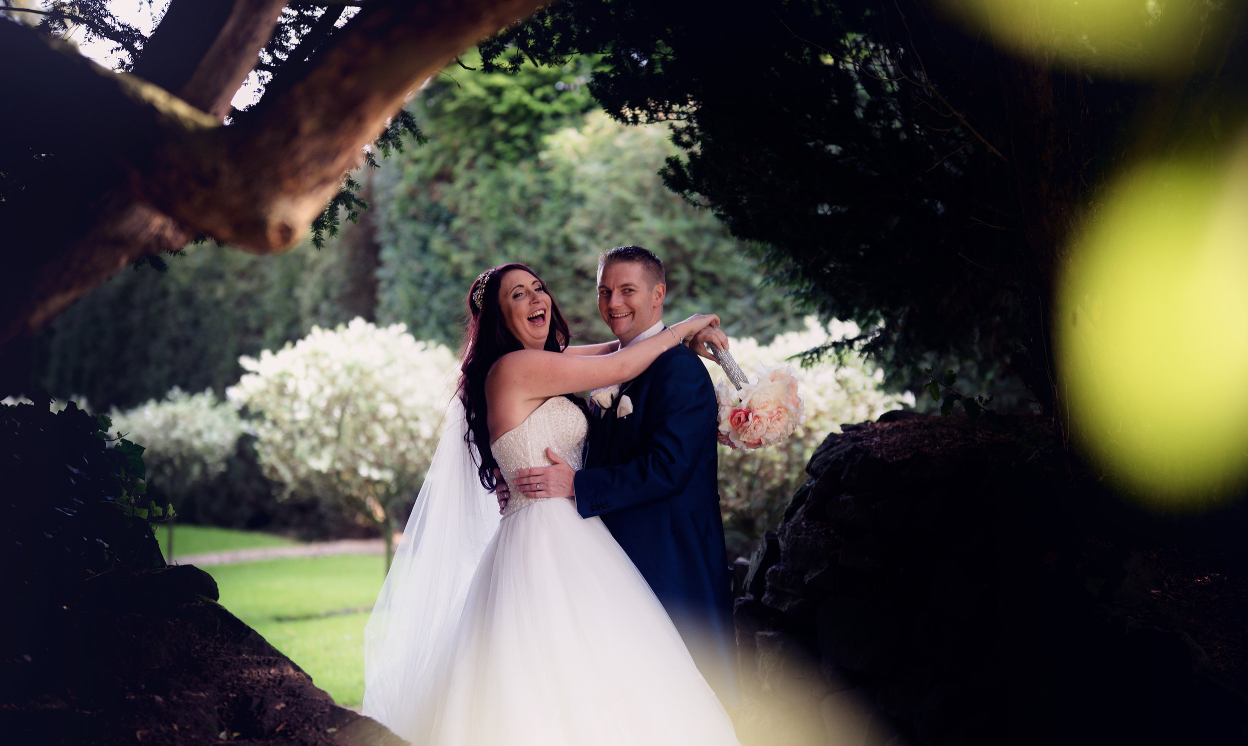 The bride and groom out in the gardens for some fun photos and a chance to escape the madness for a few minutes