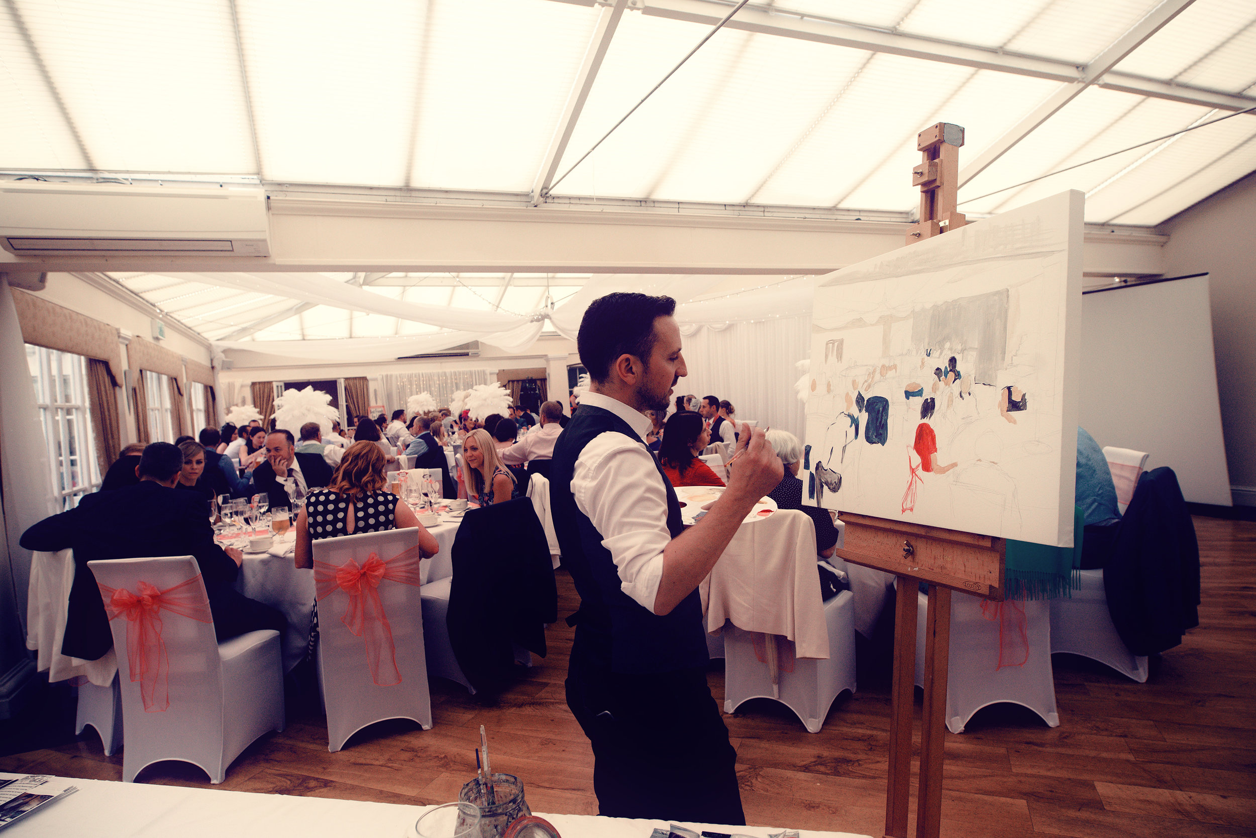 Mr Stuart Barkley Live wedding painter capturing the wedding breakfast