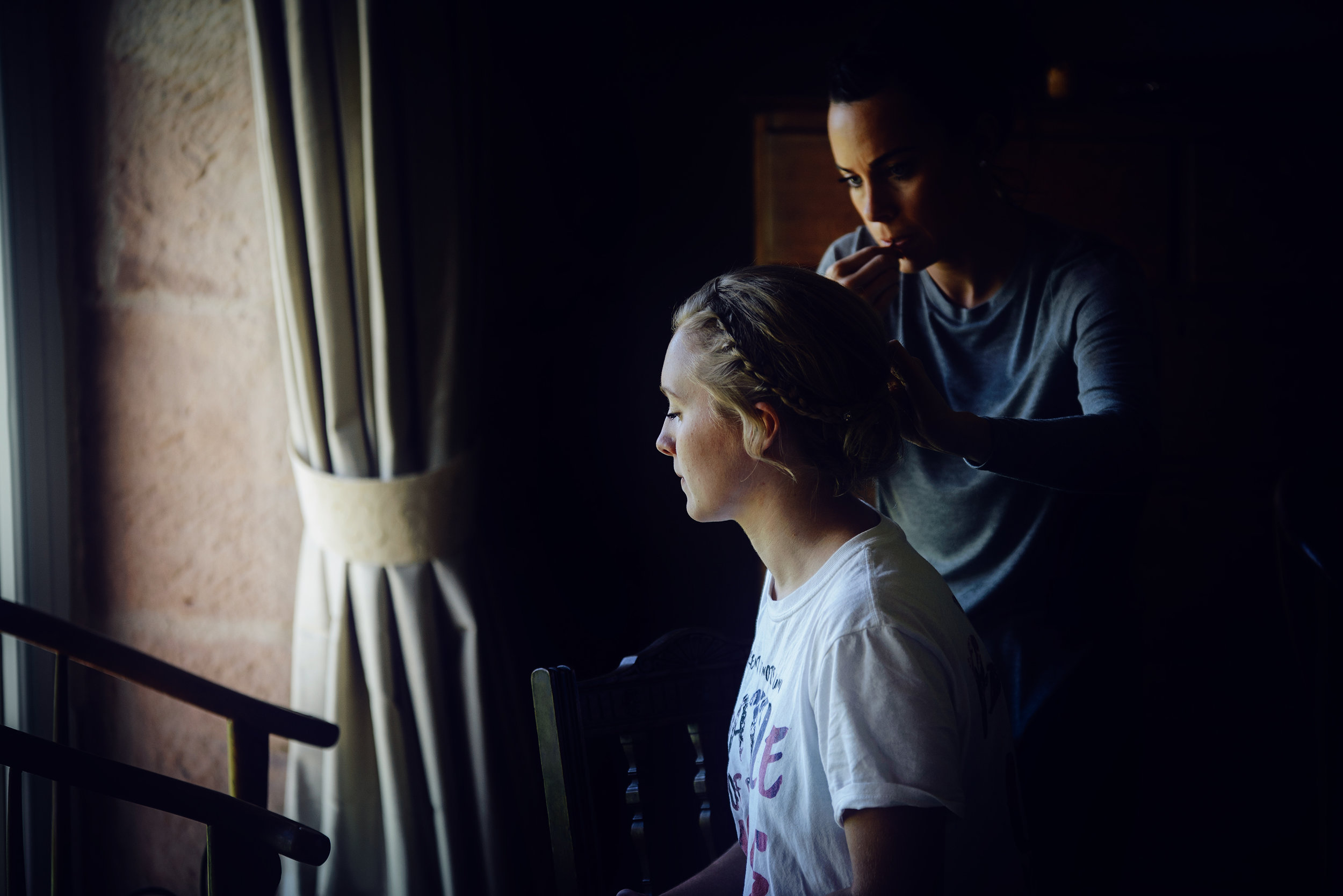 Bridesmaid having her hair and makeup done