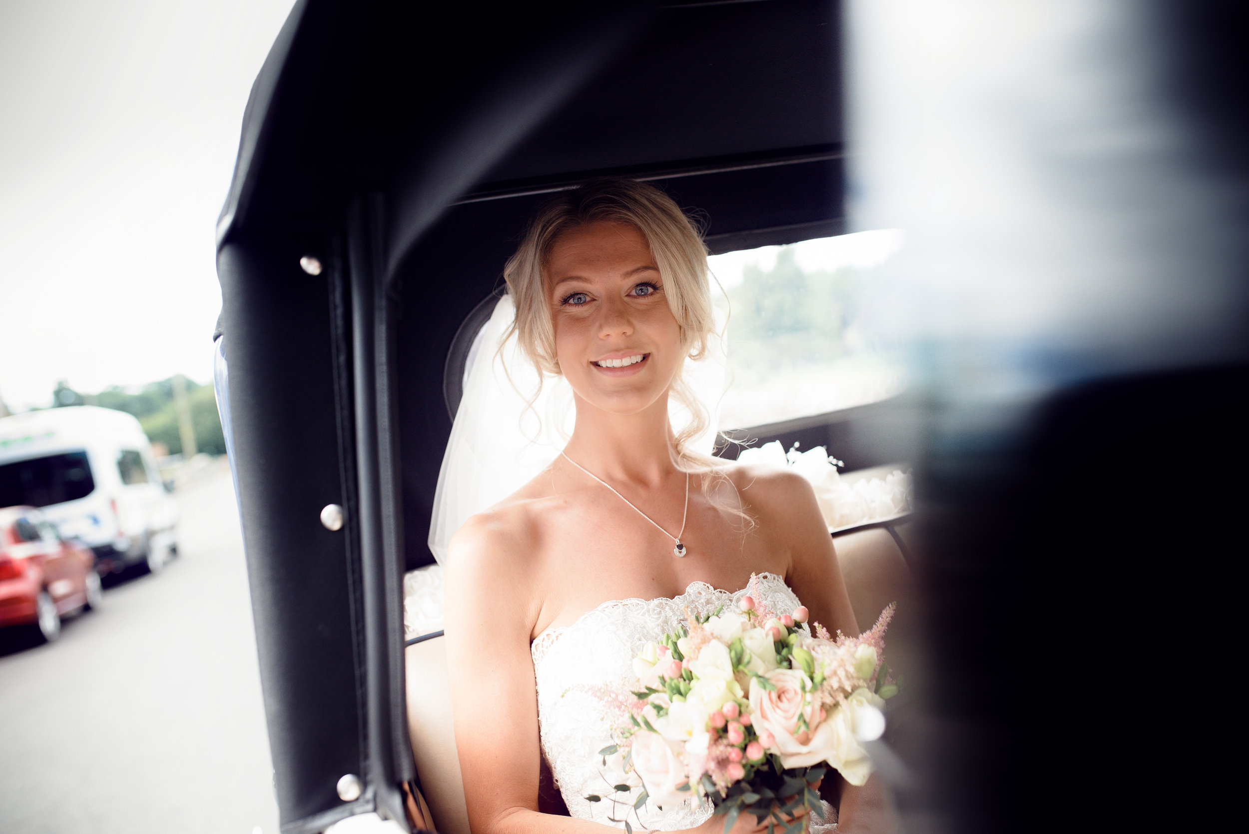 The bride sitting in the car arriving at the church