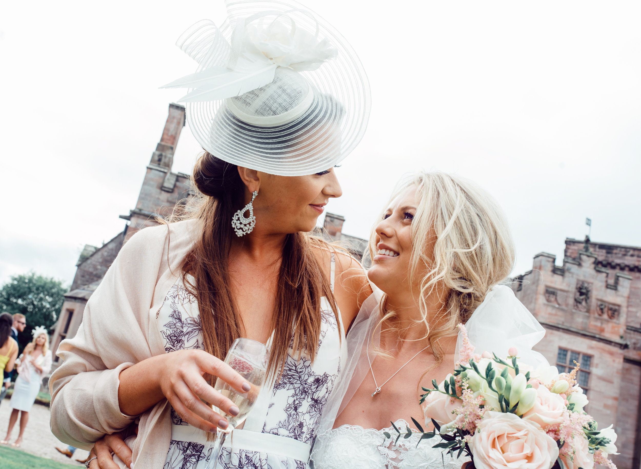 The bride having a laugh with one of her friends