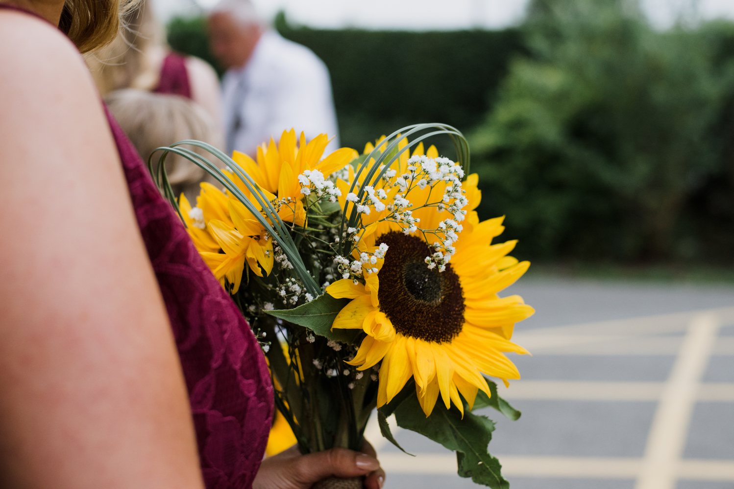 Sunflowers everywhere the bridesmaids bouquet