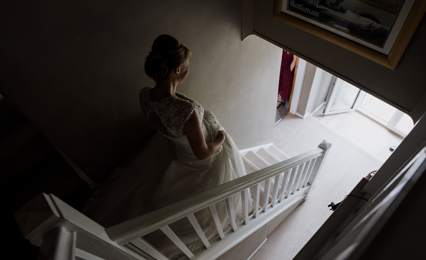 The bride walking down the stairs towards her waiting father