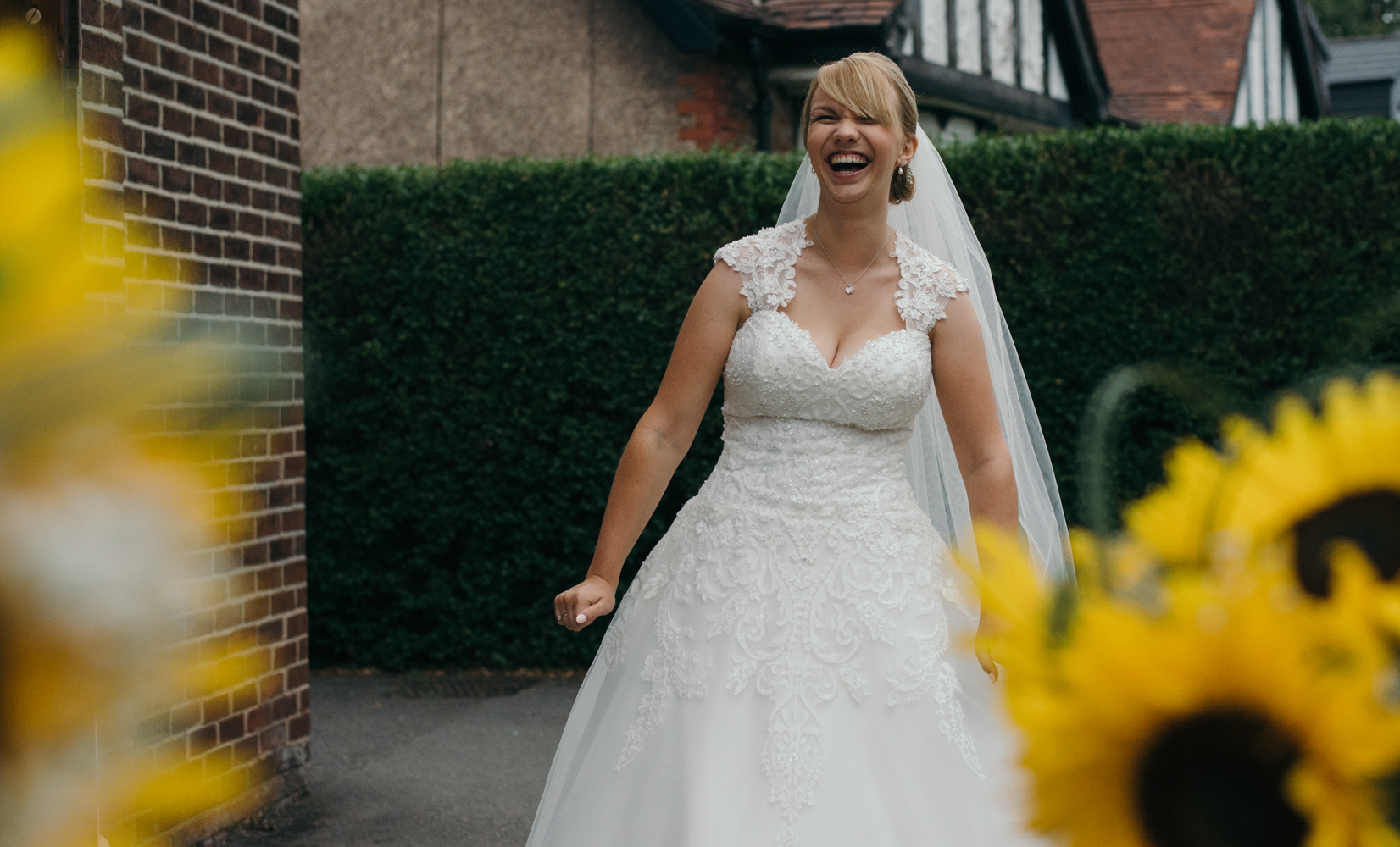 The bride acting silly before going in to church for her wedding ceremony