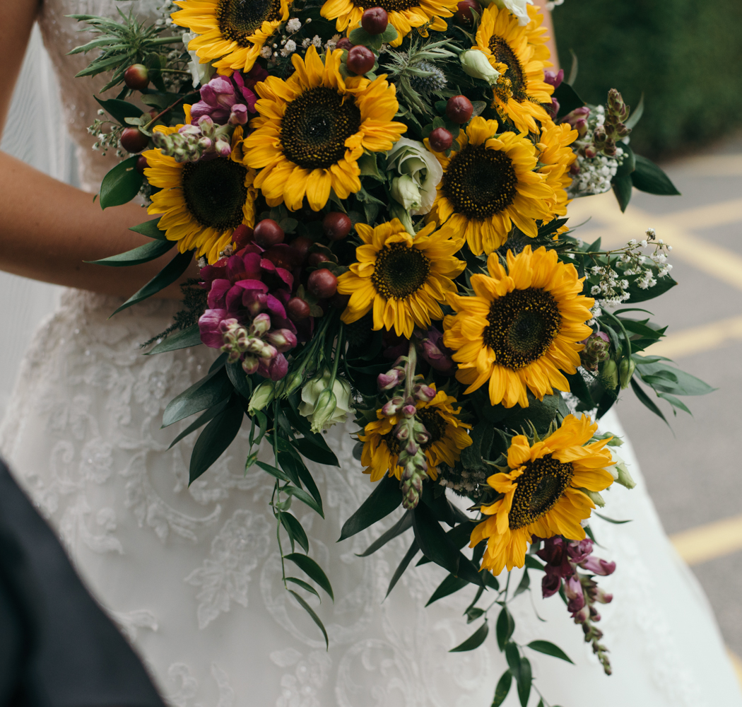 It's those sunflowers again this time the brides wonderful bouquet
