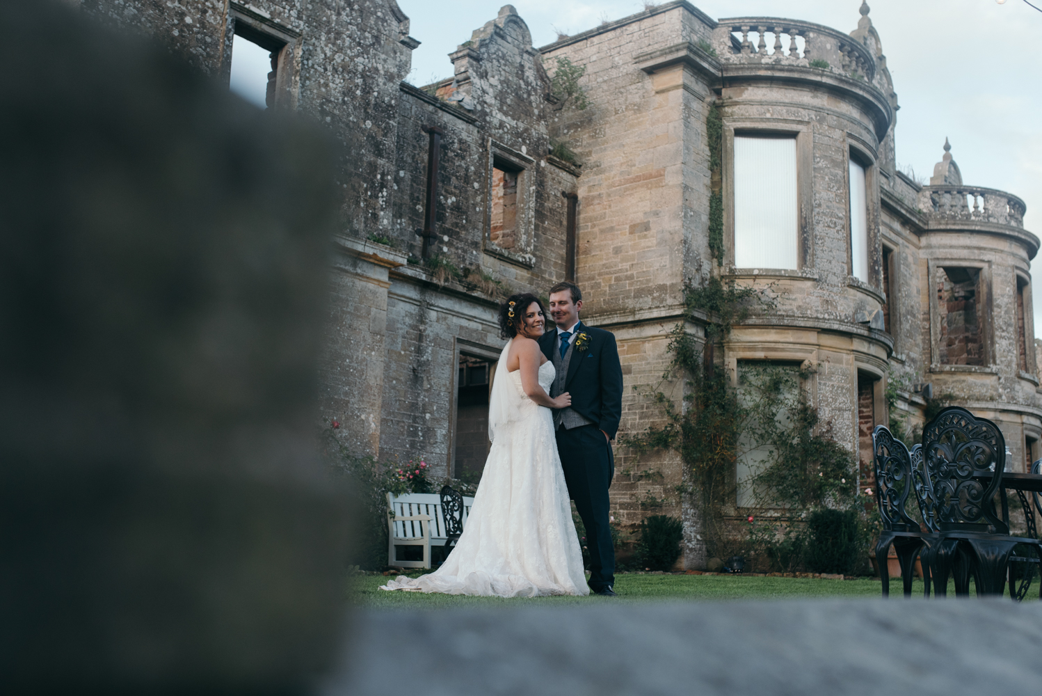 Bride and groom portrait with Kirklinton Hall in the background