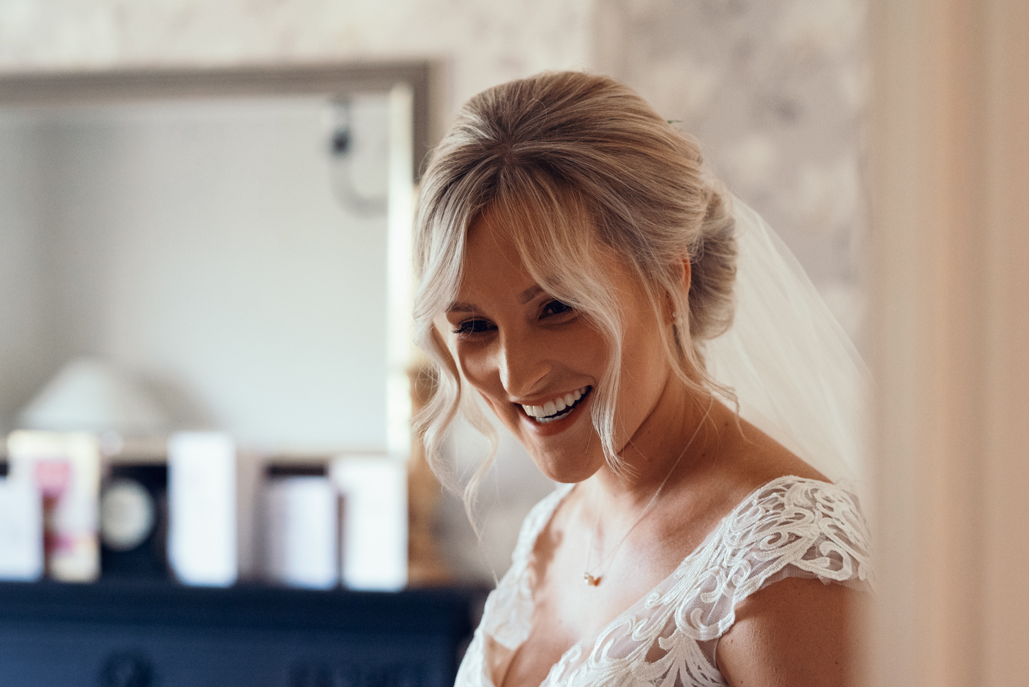 Portrait of the bride in her wedding dress before leaving home for the church