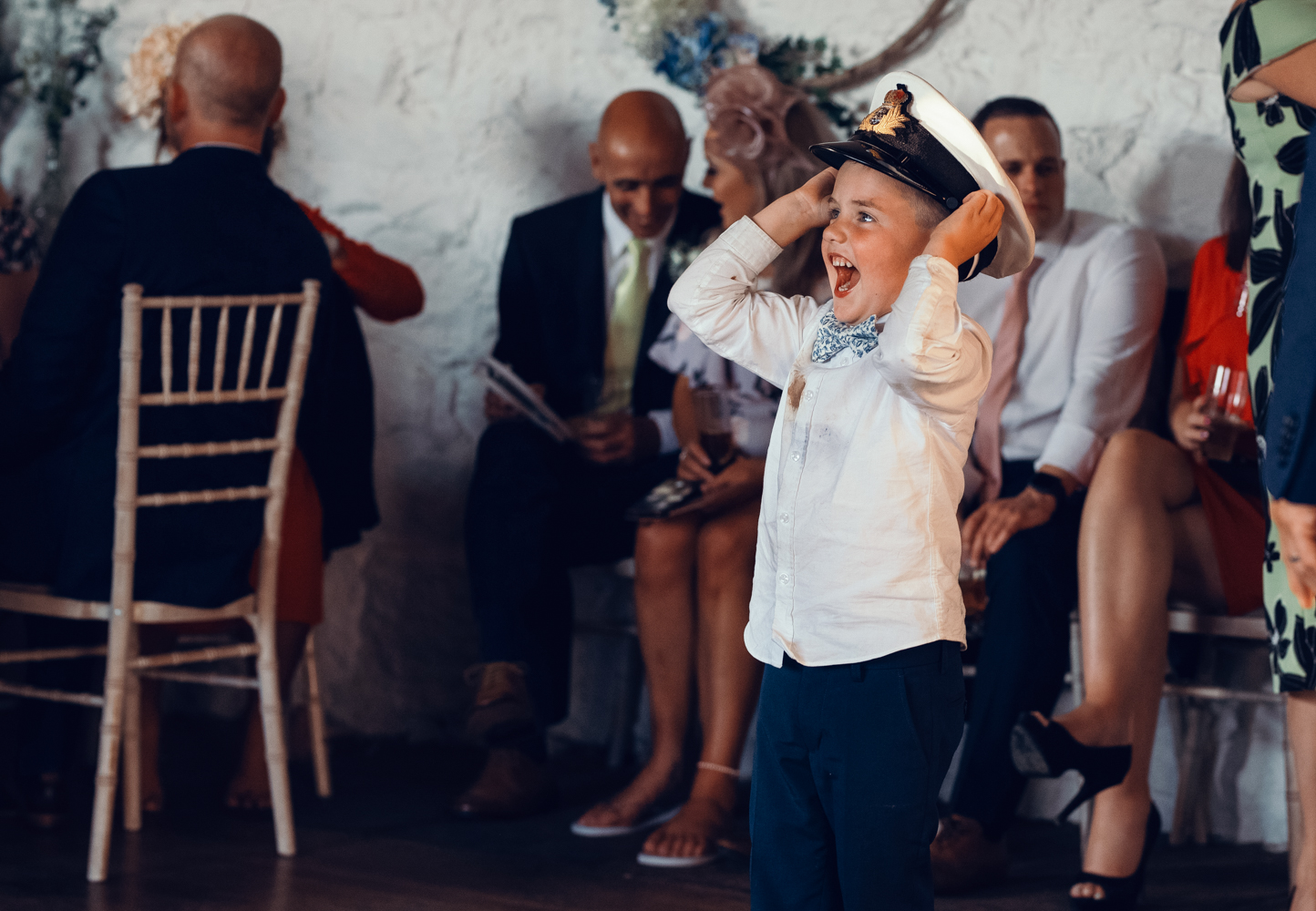 A young lad tries on a naval hat for size during the evening reception
