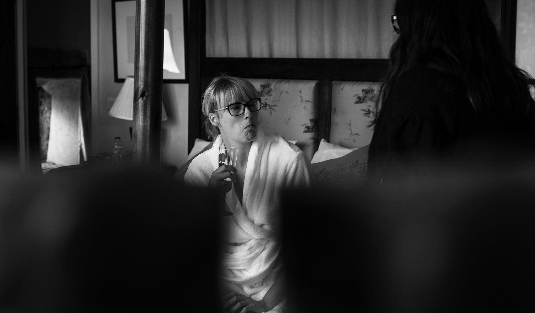 Black and white photo of a bridesmaid during bridal preparations