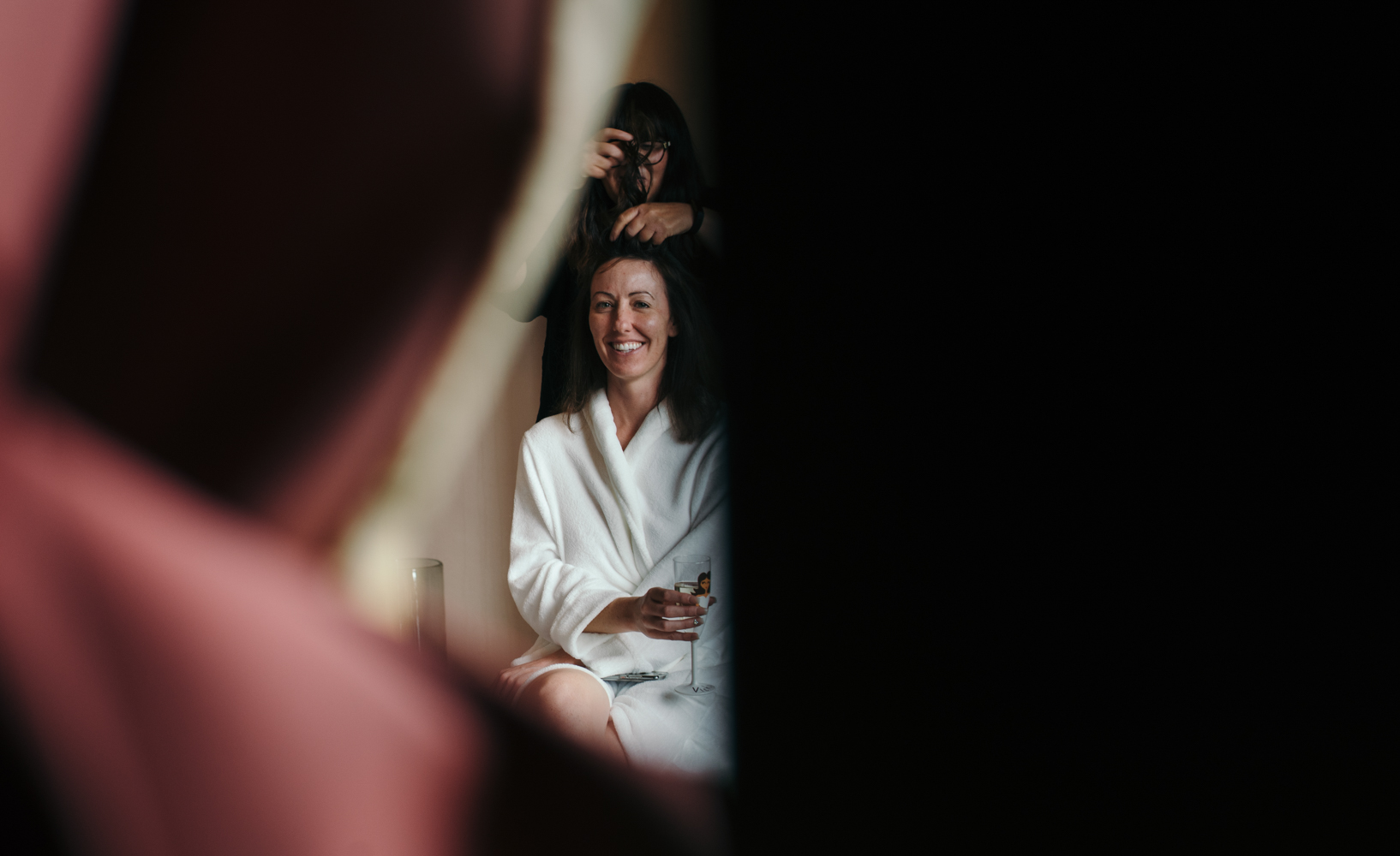 The bride Vicky having makeup and hair done during bridal preparations