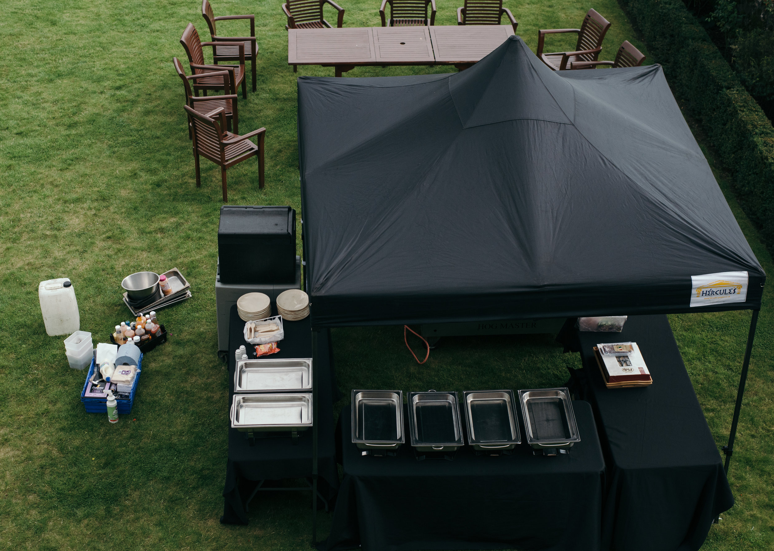 The caterers setting up for the afternoon barbecue