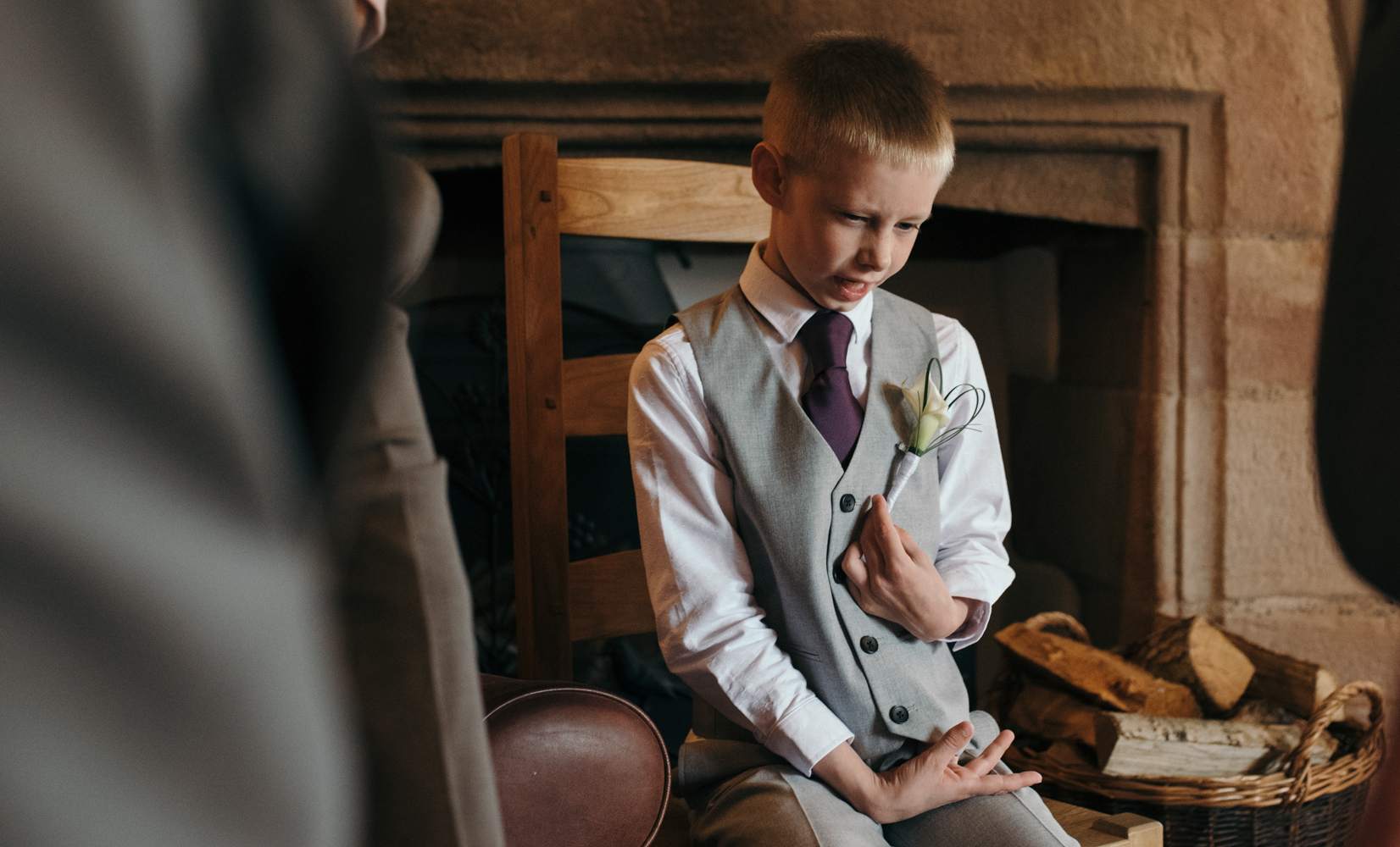 The grooms son sitting enjoying the days events