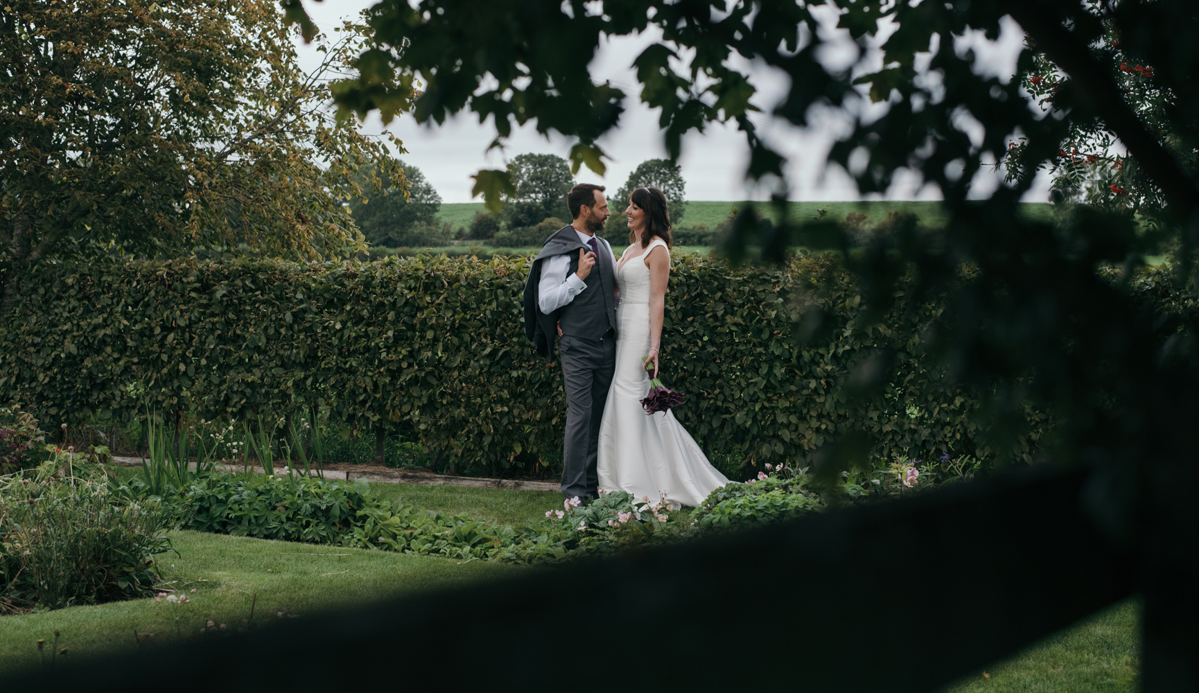 The bride and groom sharing a quiet moment in the garden