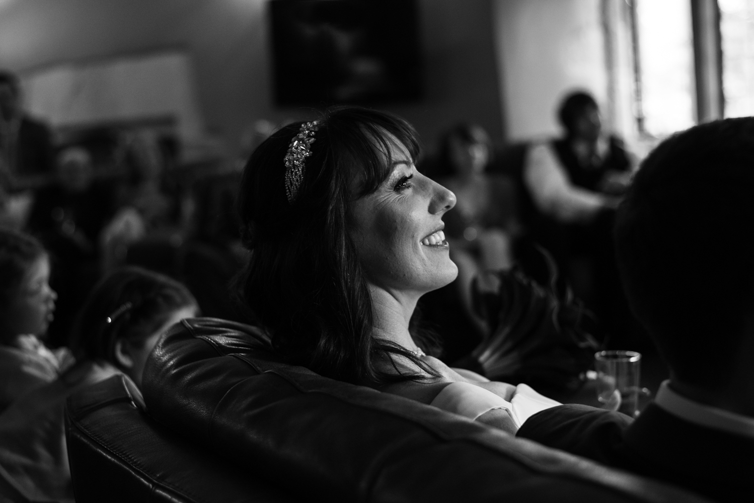 The bride enjoying the speeches pleased that she does not have to undertake the exercise