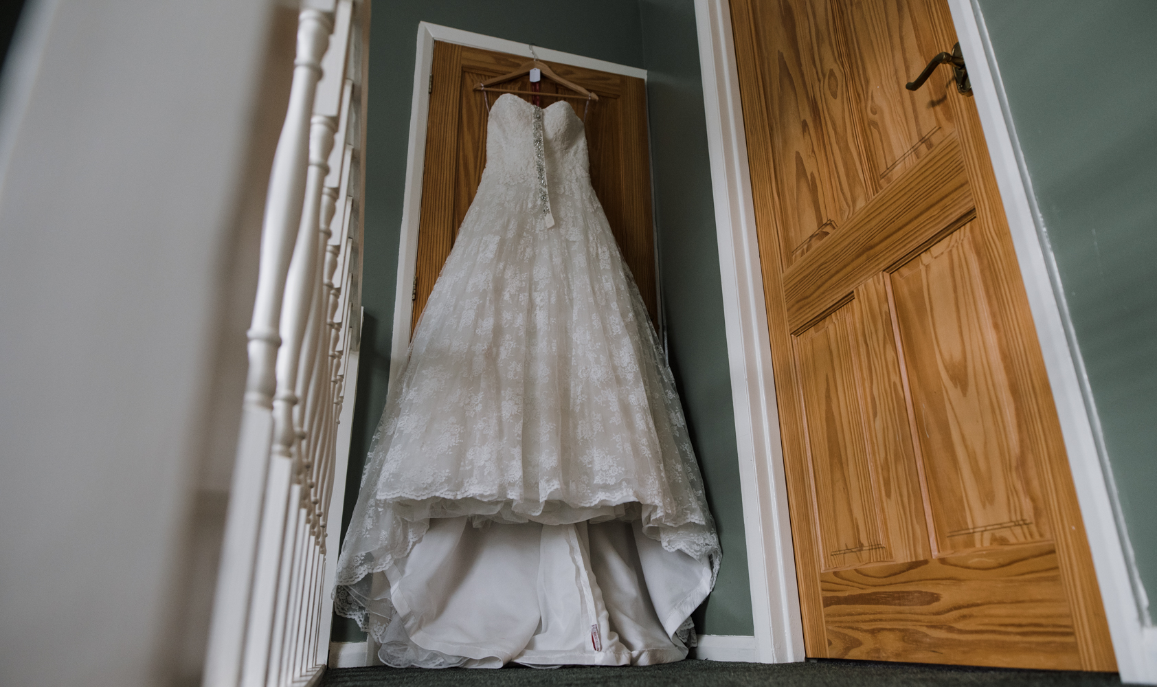 The wedding dress hanging on the landing