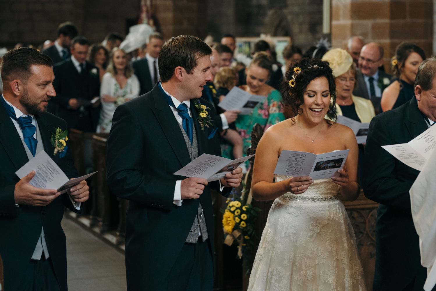 The bride and groom enjoying singing one of their chosen hymns