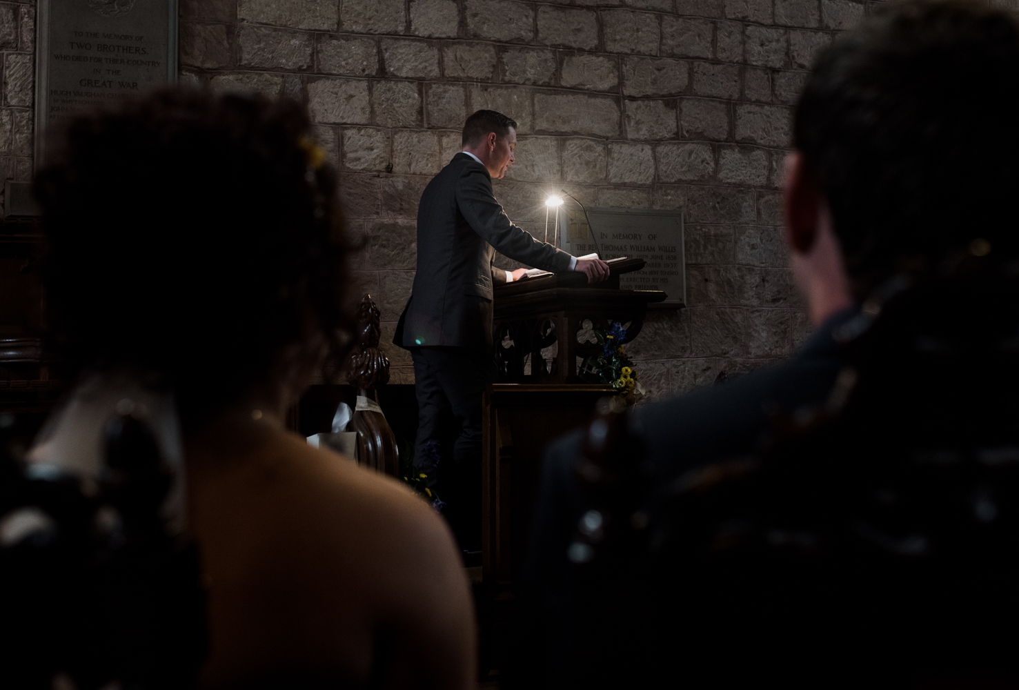One of the male guests standing giving a bible reading