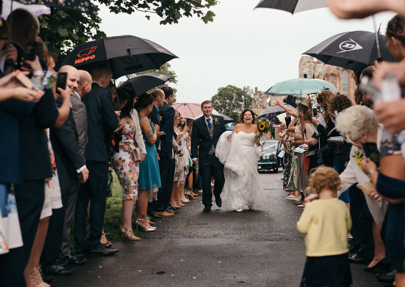 The bride and groom being showered with confetti