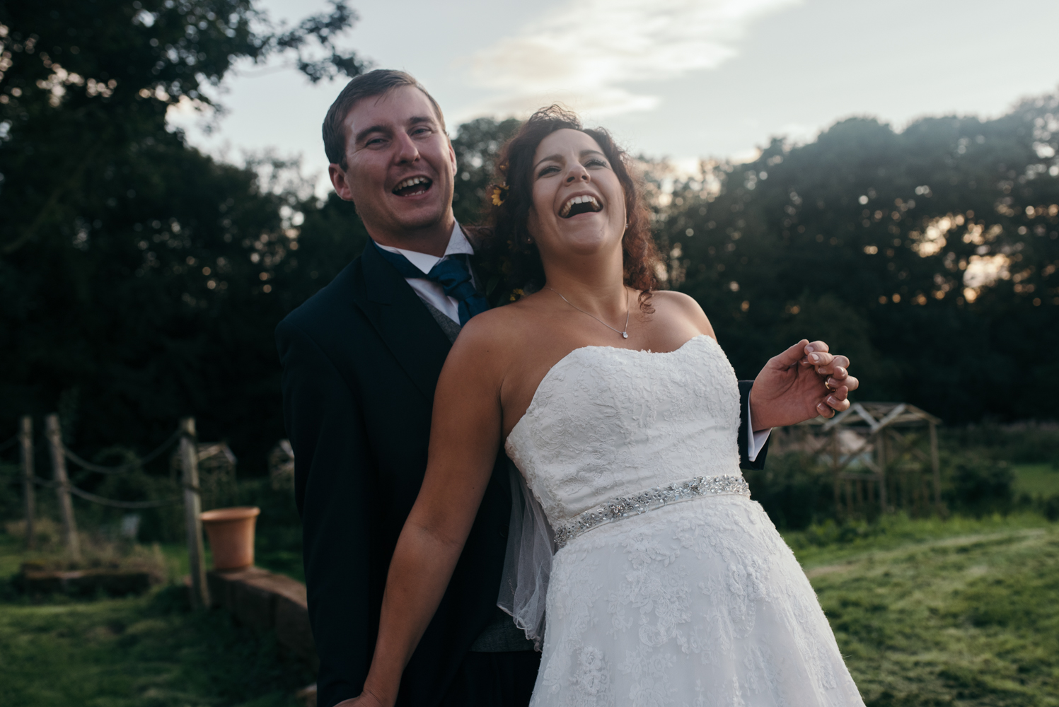 The groom tickling the bride during the portrait shoot