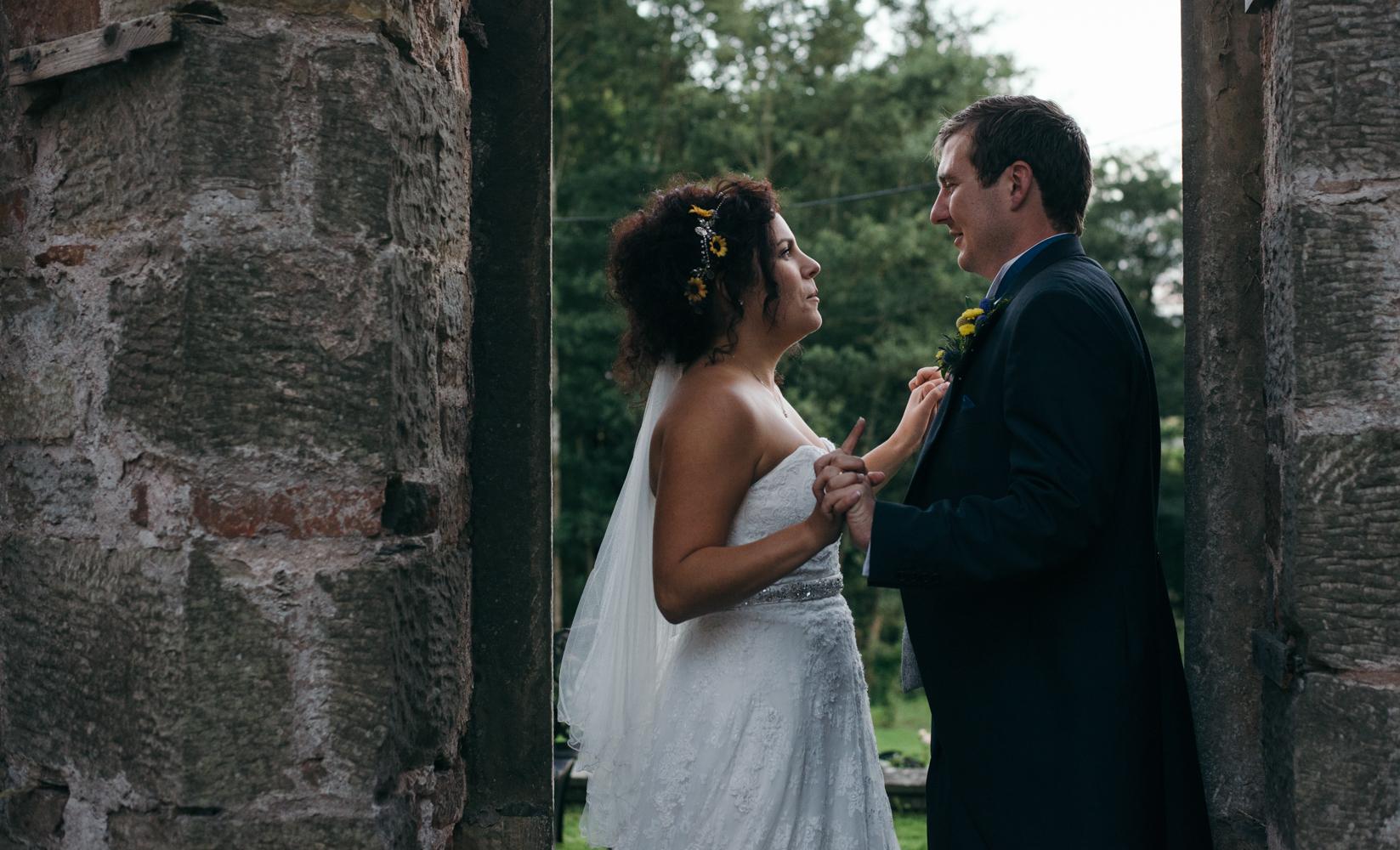 The bride and groom standing in an open doorway