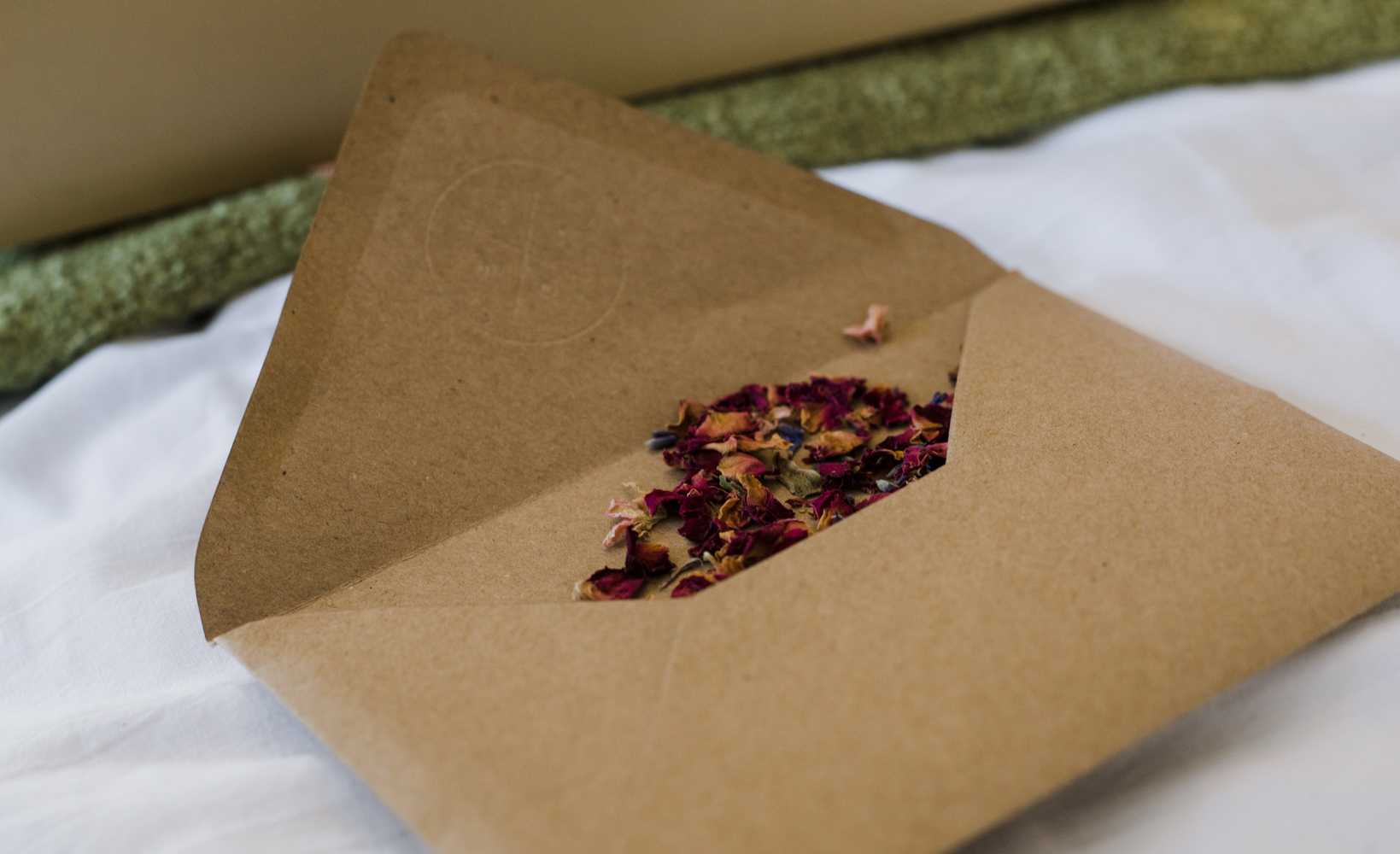 An envelope containing real flower petals to be used as confetti