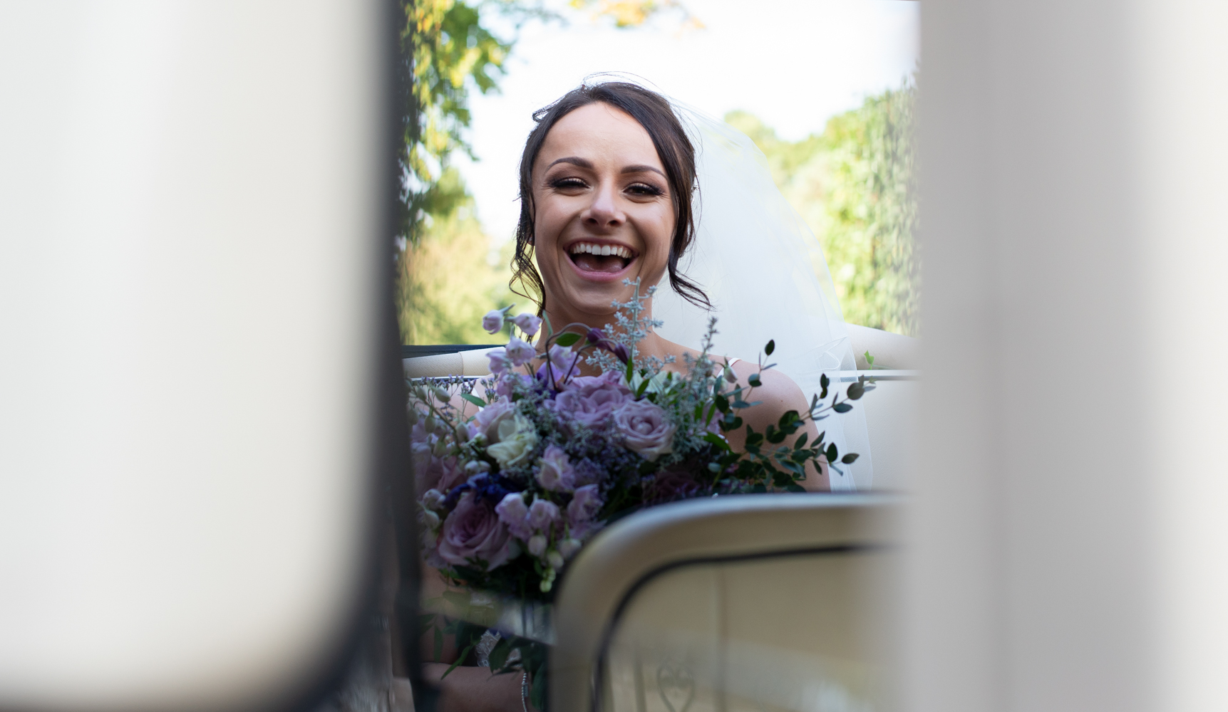 One very happy looking bride on arrival at Inglewood Manor for the wedding reception