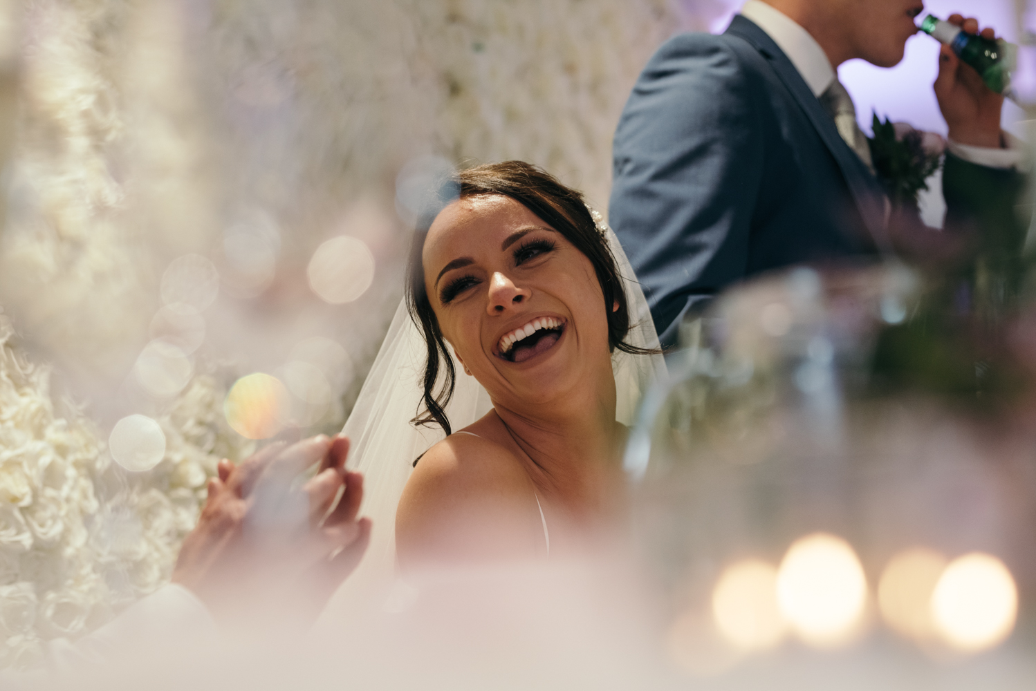 The bride laughing during the speeches