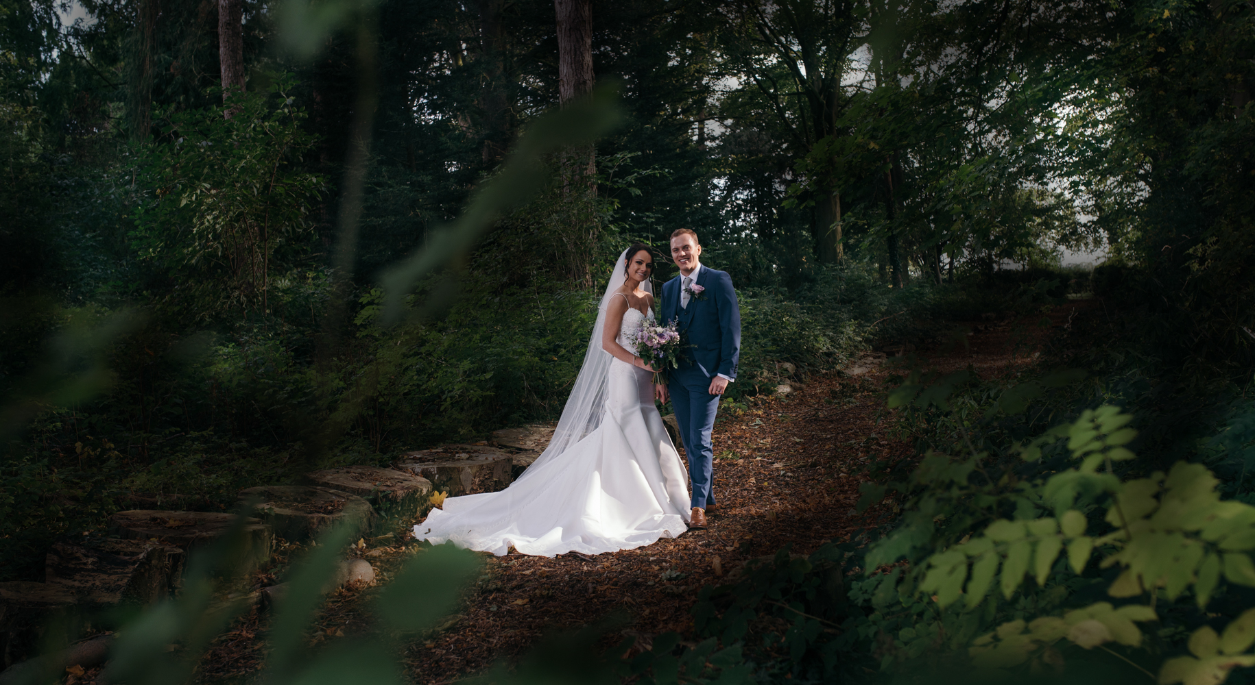 Lovely image of the bride and groom taken in the woods at Inglewood Manor
