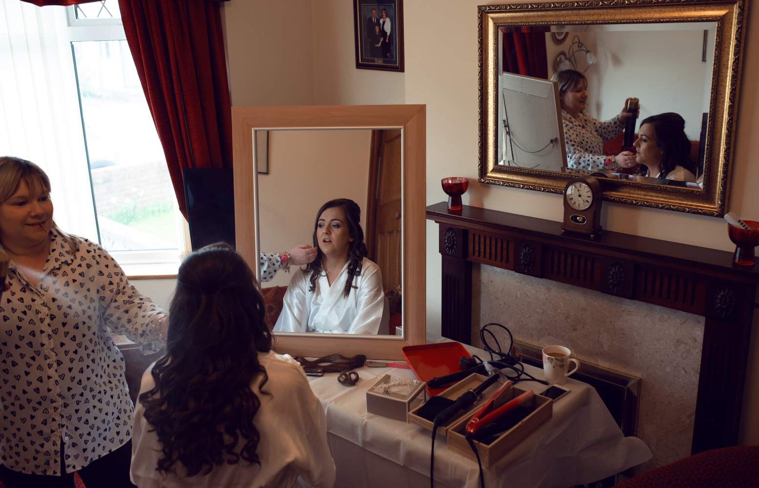 The bride during morning bridal preparations having her makeup applied