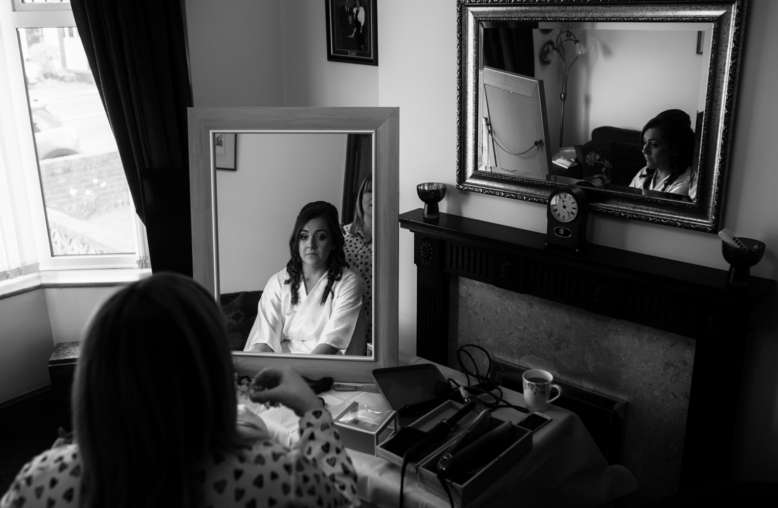 A Black and White image of the brides reflection in a mirror