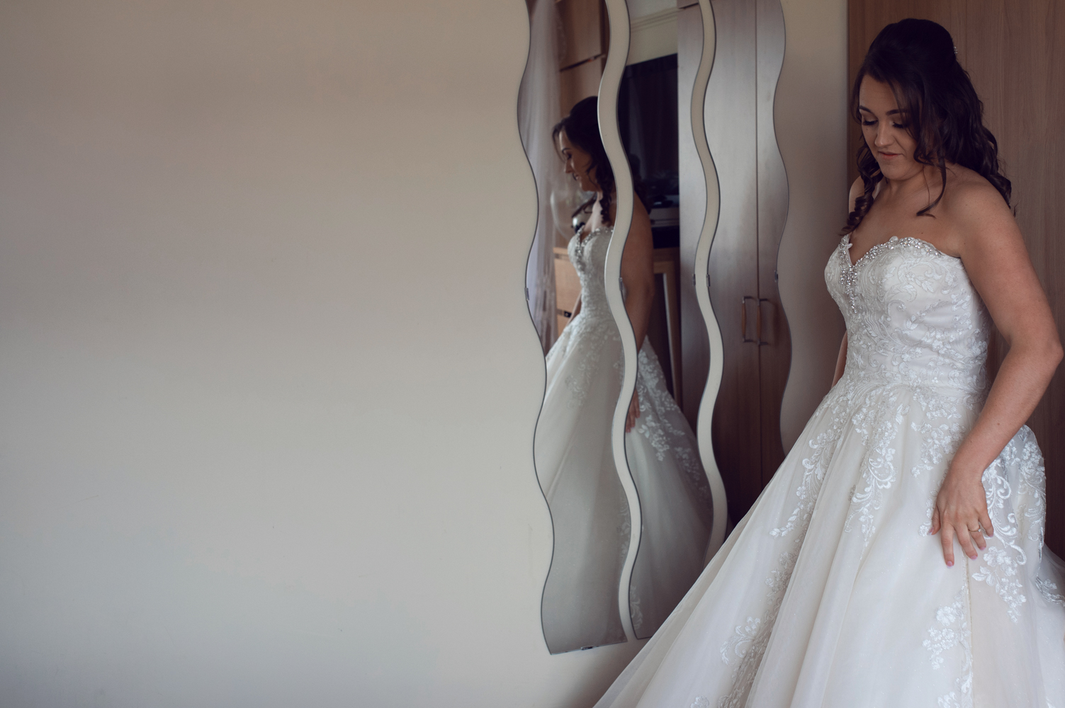 Photo of the bride in the quirky wall mirror