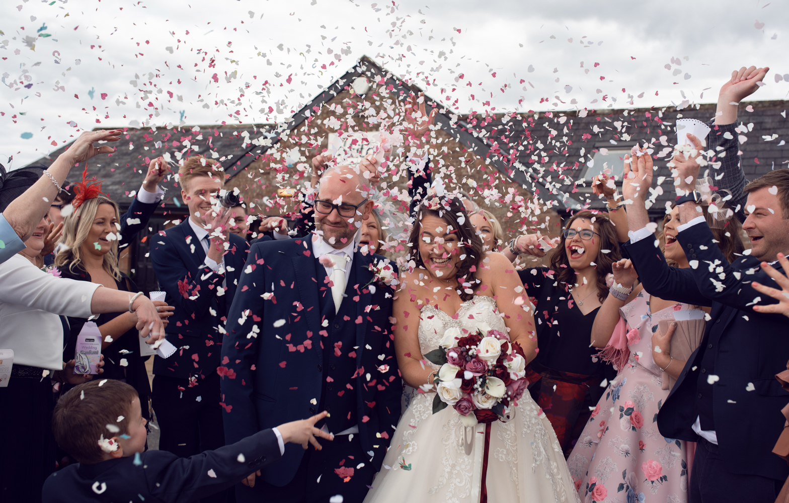 Bride and groom during the manic confetti shower
