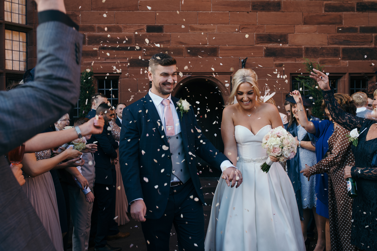 The bride and groom during the confetti shower