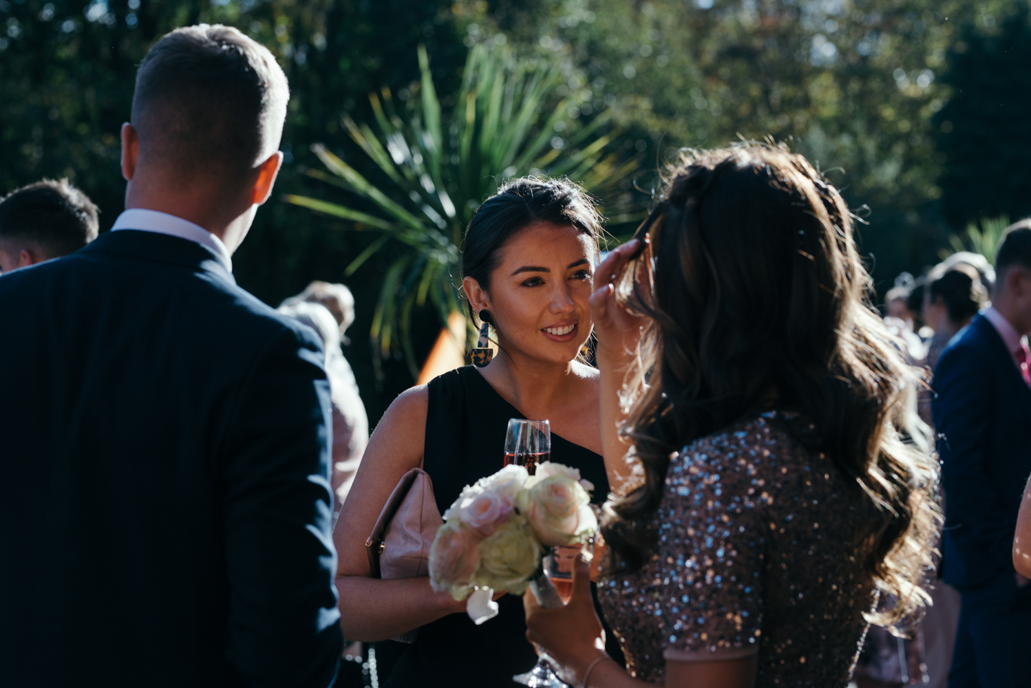 Another candid photo of one of the wedding guests during the drinks reception