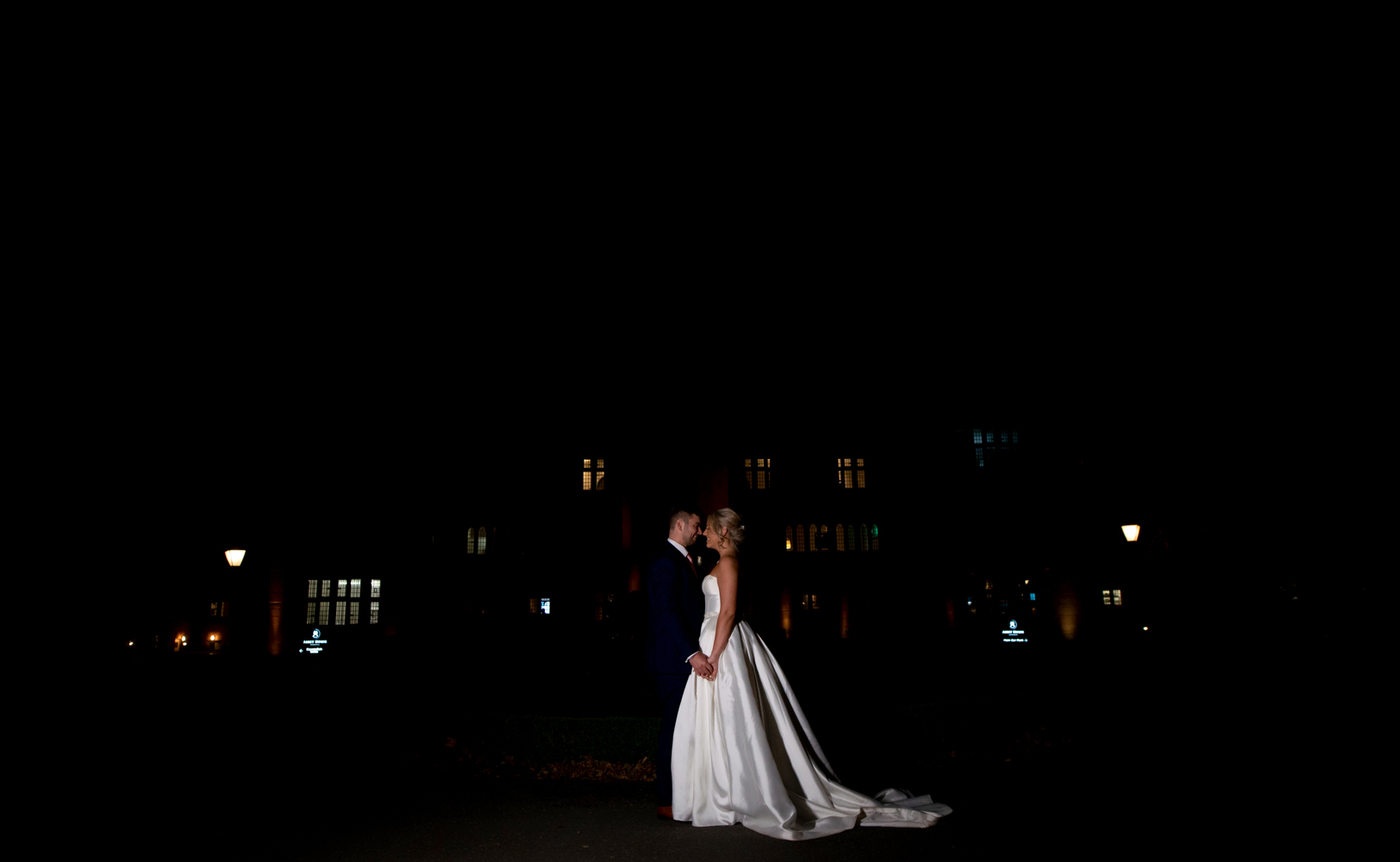 The happy couple outside the Abbey House Hotel in the dark