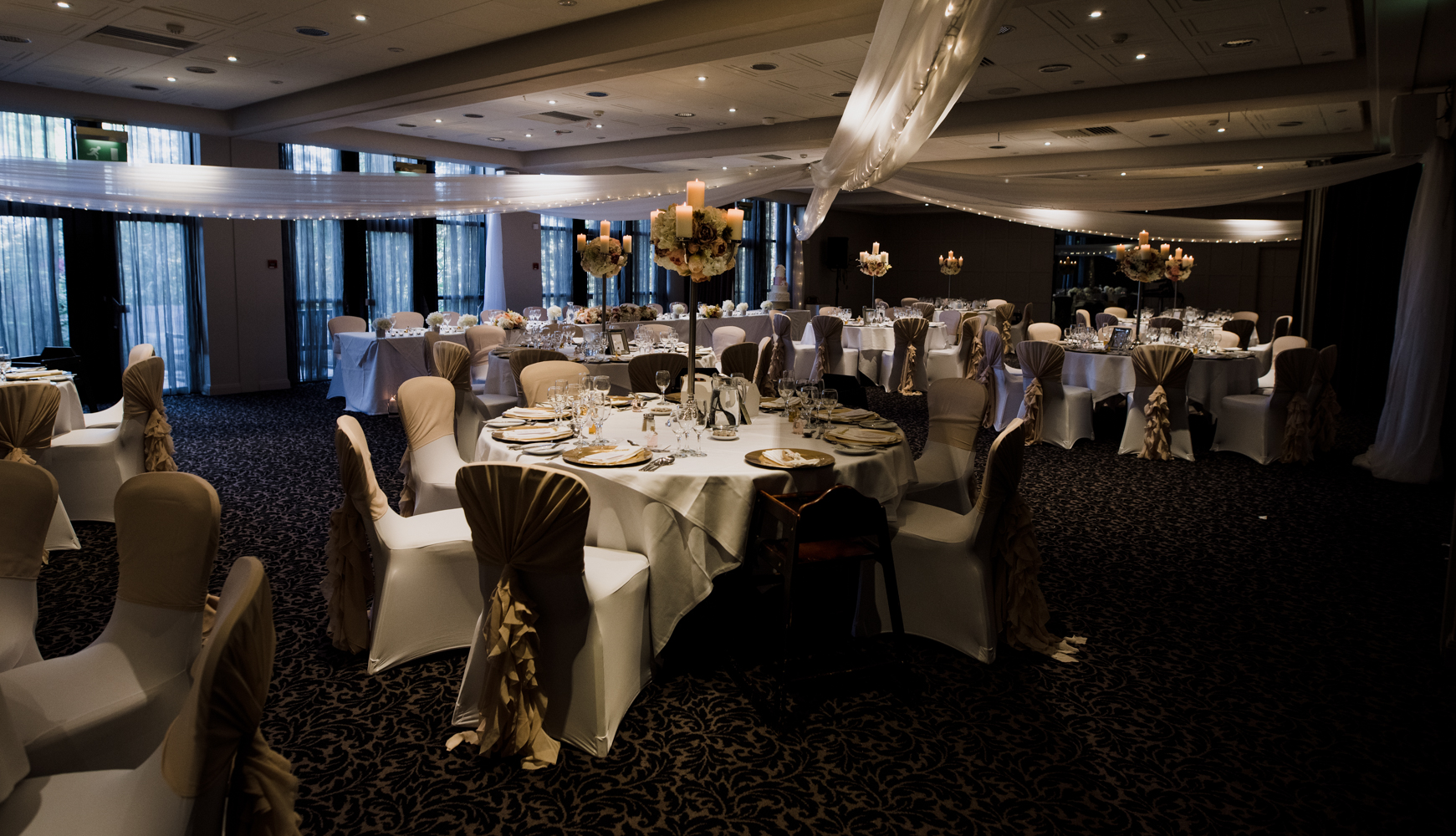 A wide angle image of the wedding reception room all set up for the wedding breakfast