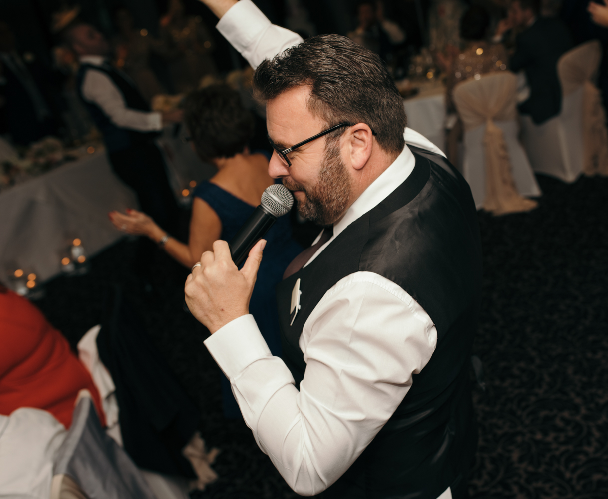 Photo of one of the singing waiters during their set