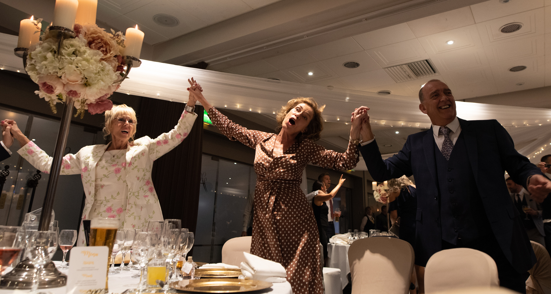 Some of the guests dancing and singing along with the singing waiters
