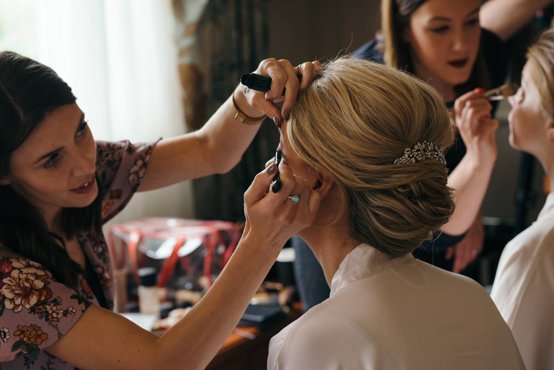 The bride having her eye makeup applied