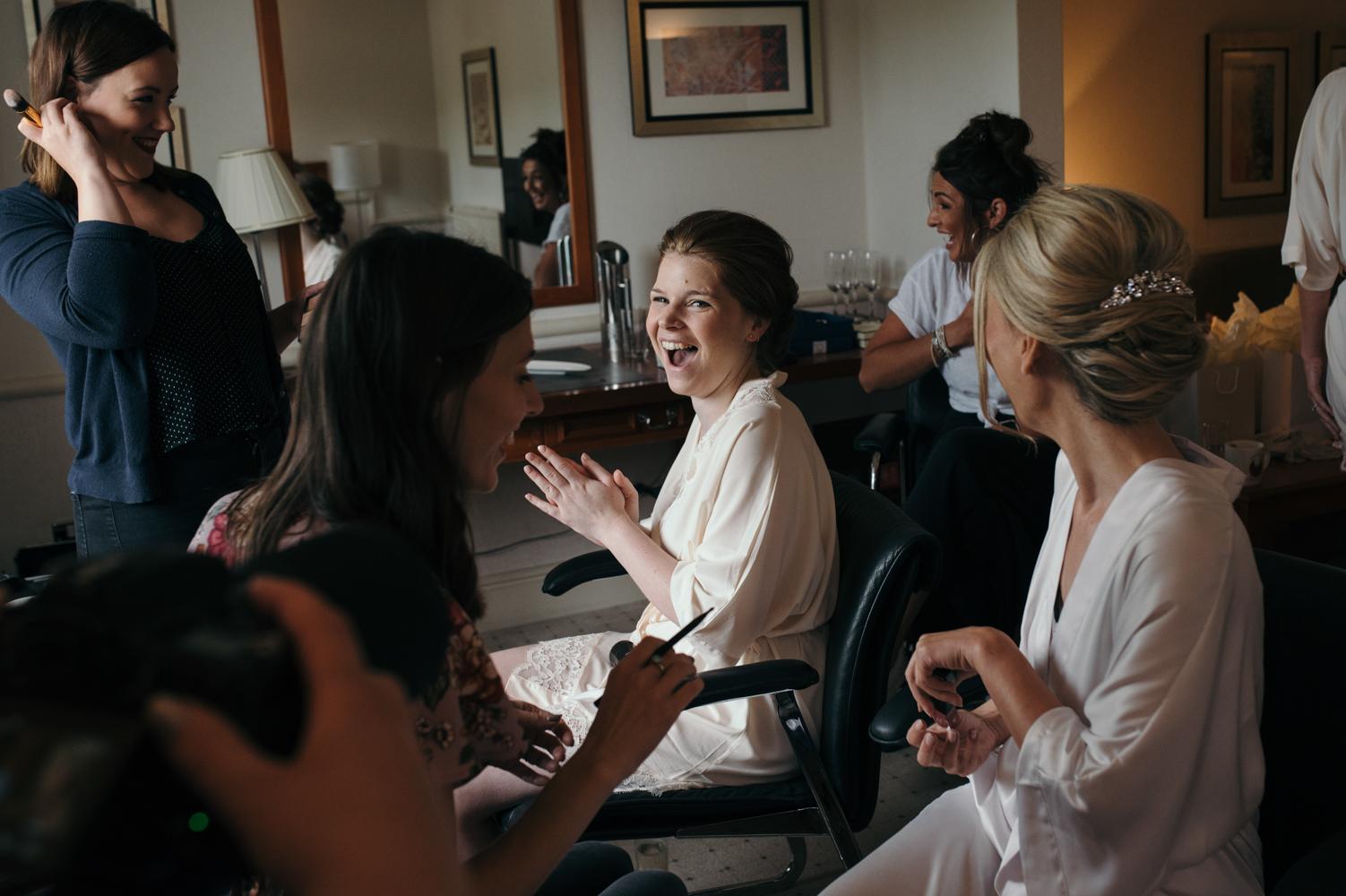 A bridesmaid having a good laugh during morning preparations