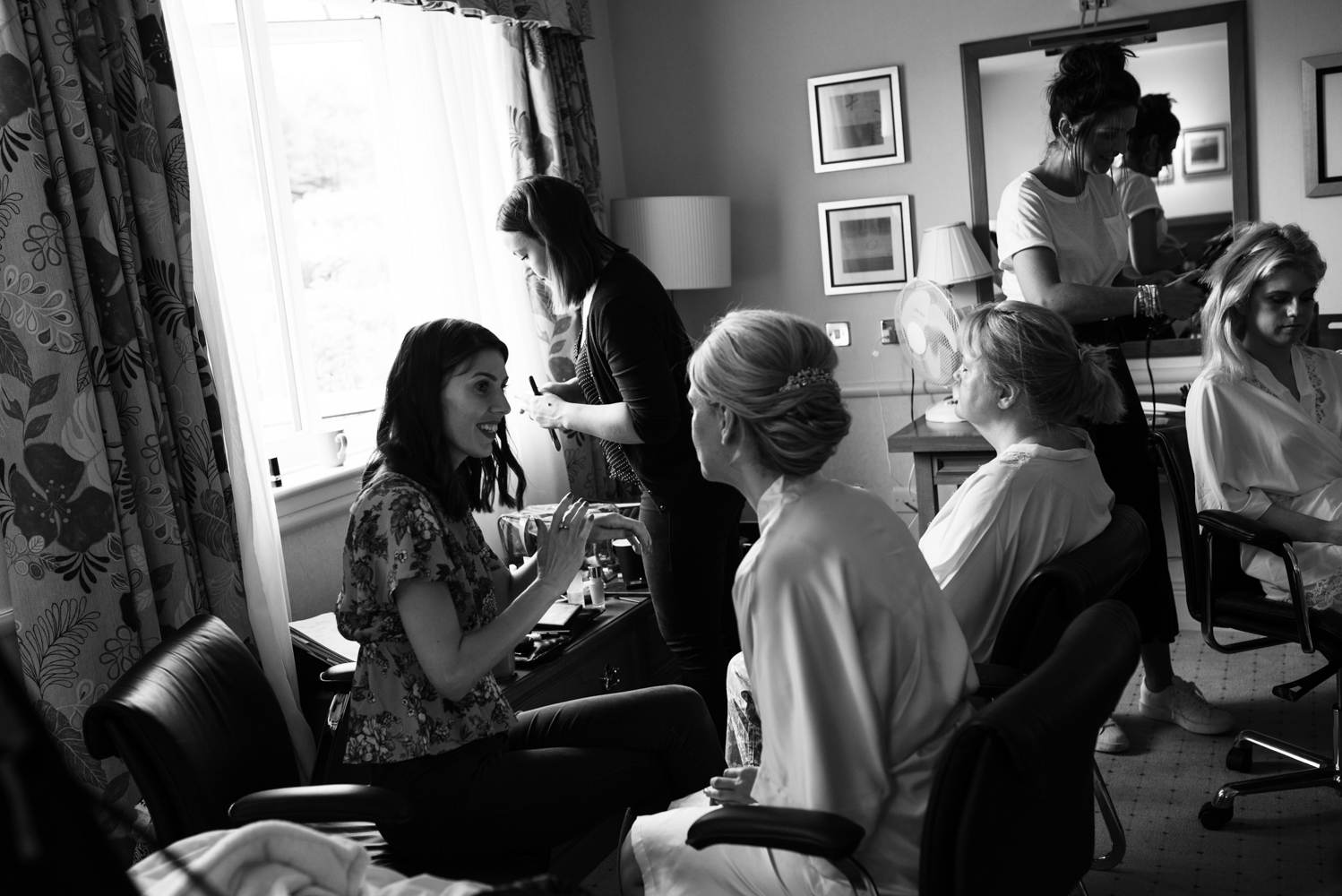 Another black and white photo of the the bride and bridesmaids during preparations