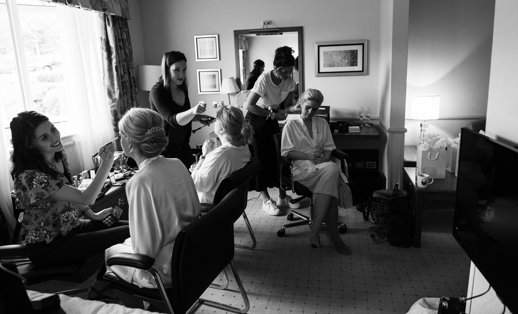 A black and white whole room photo during bridal preparations