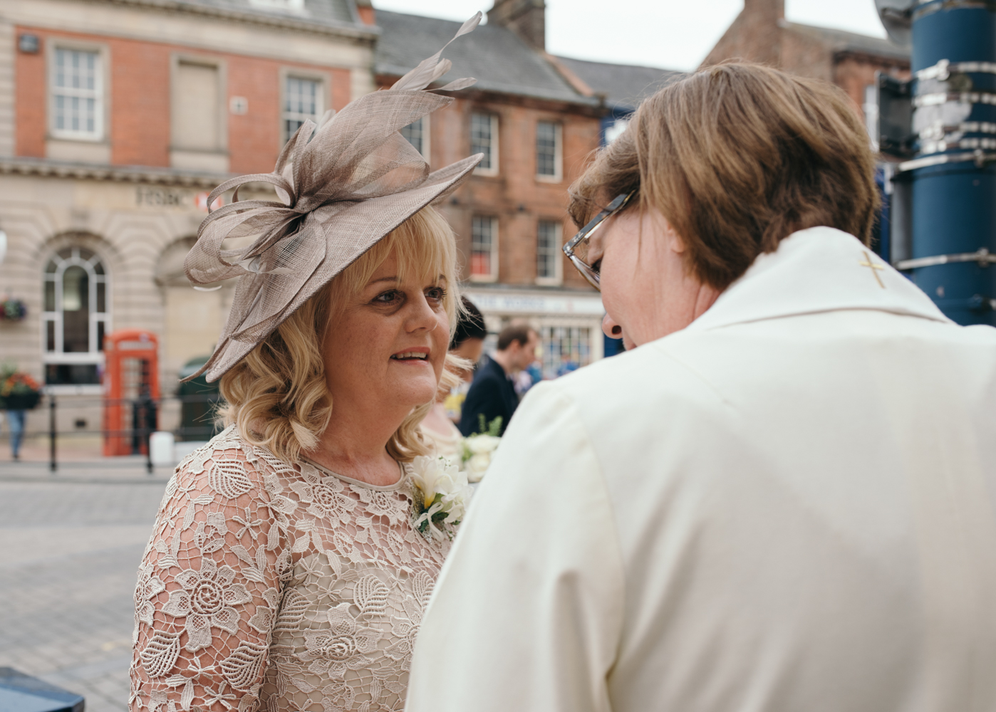 The brides mother chatting to the vicar prior to the wedding ceremony