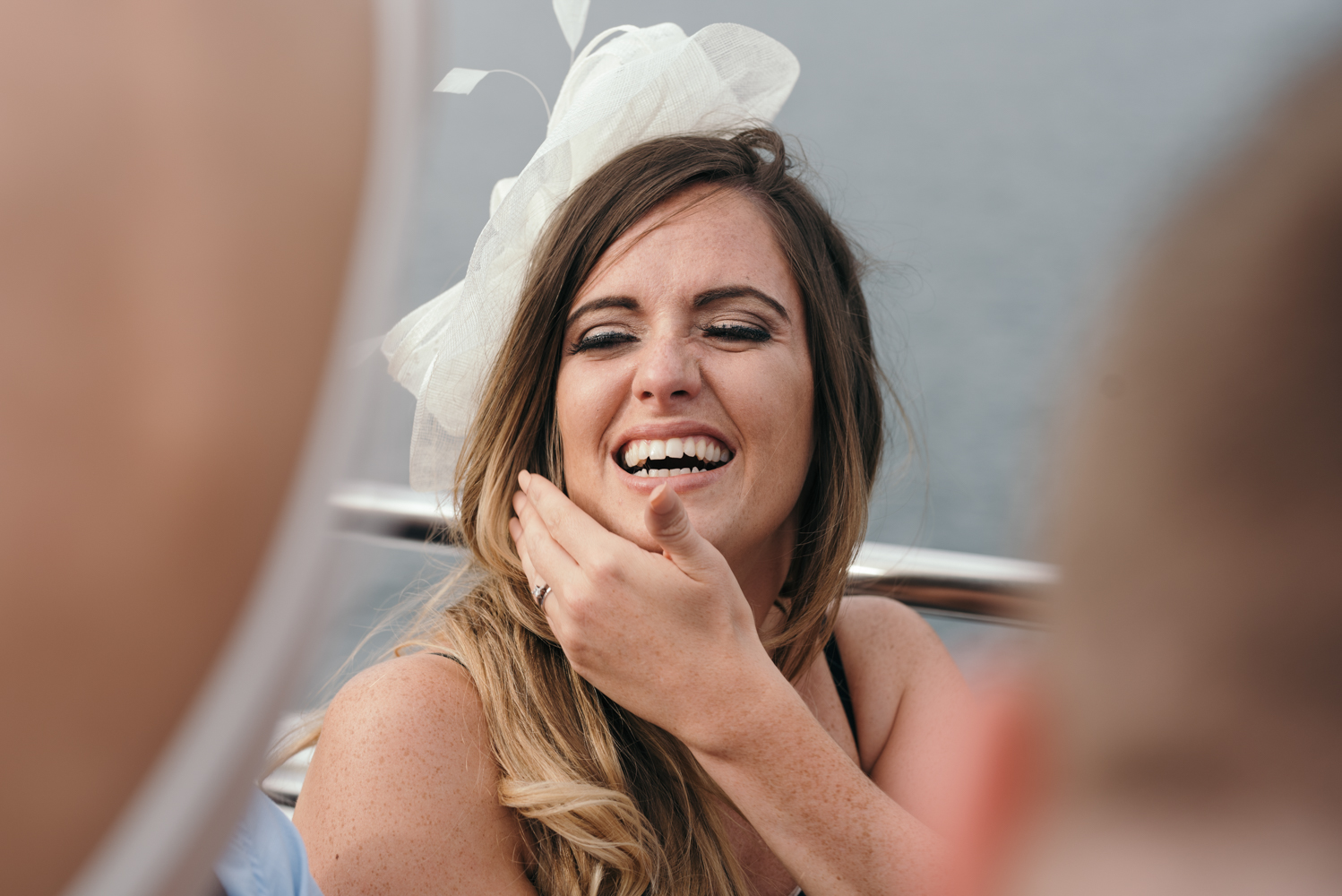 One of the wedding guests goofing around during the lake cruise
