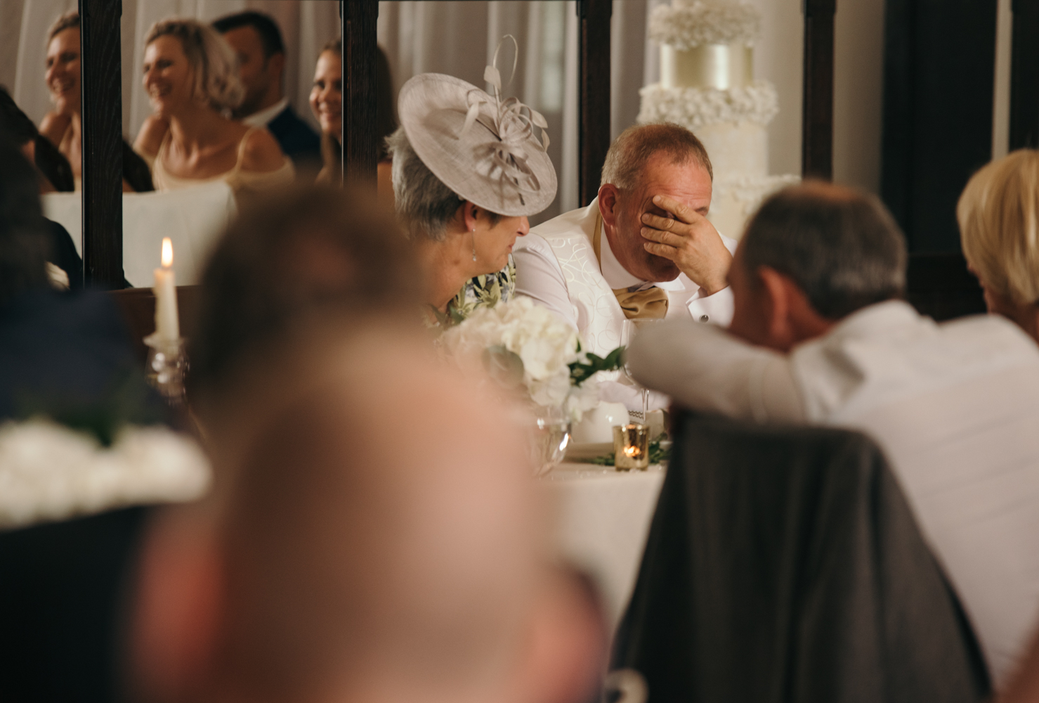 The grooms father hides his face in shame as one of his exploits are revealed during the stag weekend is revealed to the guests
