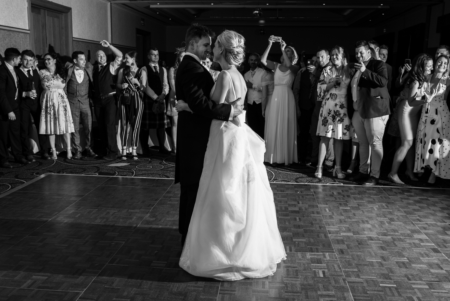 A black and white photo of the bride and groom during the first dance